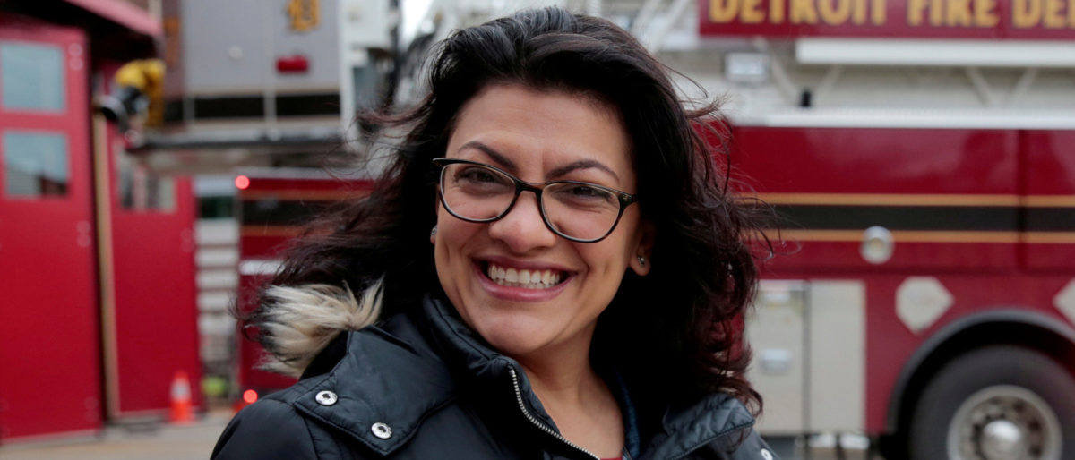 Democratic U.S. congressional candidate Rashida Tlaib points to her 'I voted' sticker after voting during the midterm election in Detroit, Michigan. REUTERS/Rebecca Cook