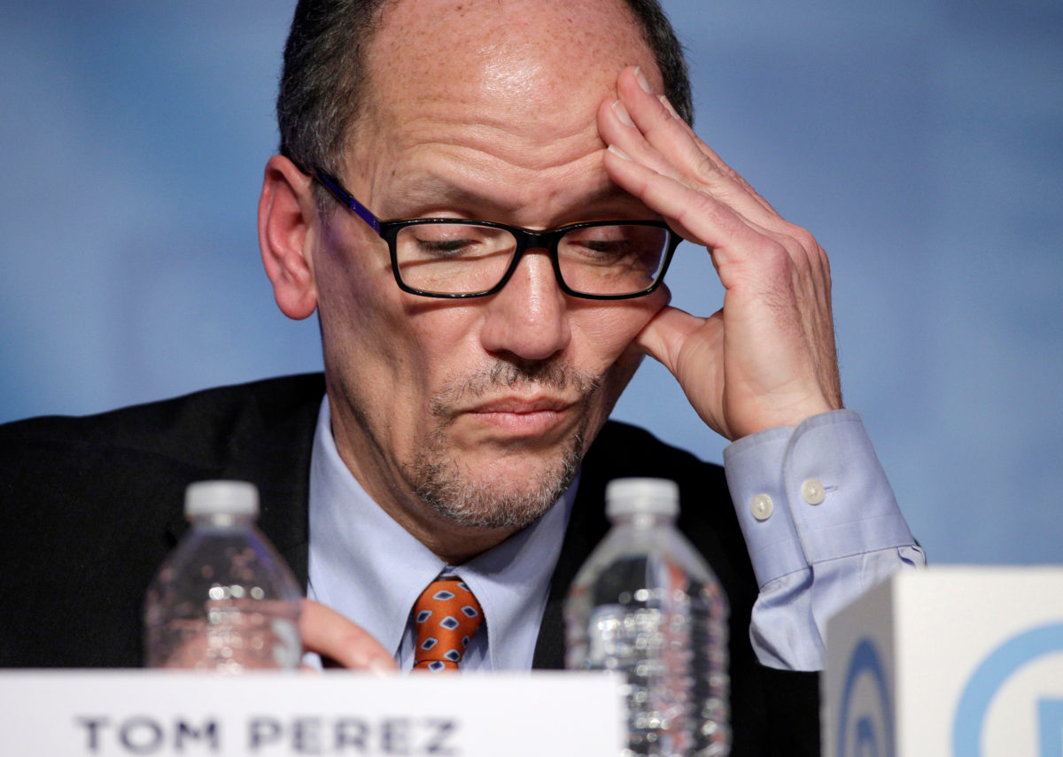 Former Secretary of Labor Tom Perez, a candidate for Democratic National Committee Chairman, looks at his notes during a Democratic National Committee forum in Baltimore, Maryland.