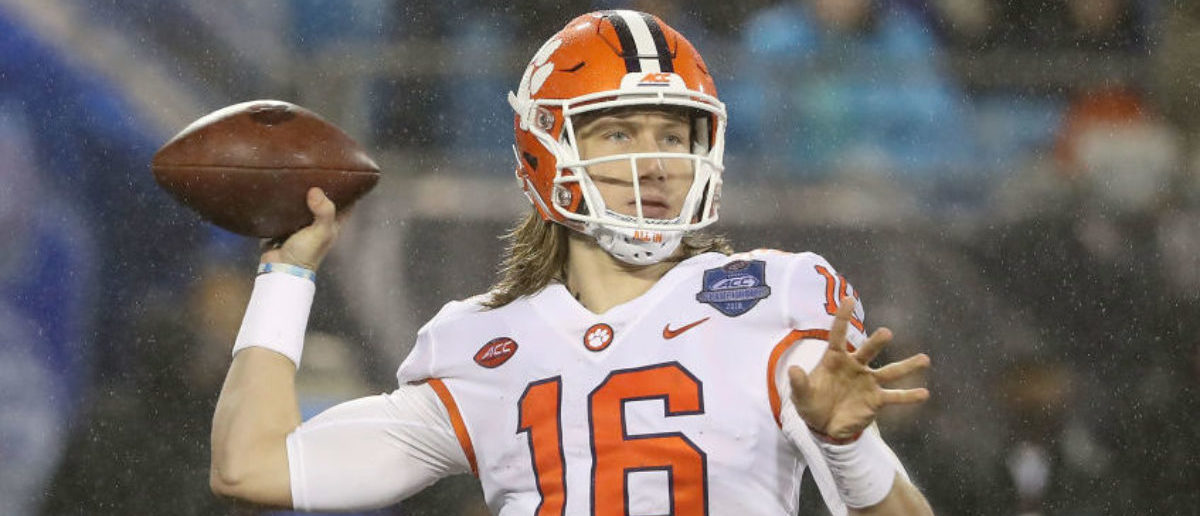 CHARLOTTE, NC - DECEMBER 01: Trevor Lawrence #16 of the Clemson Tigers drops back to pass against the Pittsburgh Panthers during their game at Bank of America Stadium on December 1, 2018 in Charlotte, North Carolina. (Photo by Streeter Lecka/Getty Images)