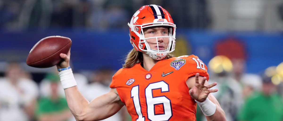 ARLINGTON, TEXAS - DECEMBER 29: Trevor Lawrence #16 of the Clemson Tigers throws a 19 yard touchdown pass in the second quarter against the Notre Dame Fighting Irish during the College Football Playoff Semifinal Goodyear Cotton Bowl Classic at AT&T Stadium on December 29, 2018 in Arlington, Texas. (Photo by Tom Pennington/Getty Images)