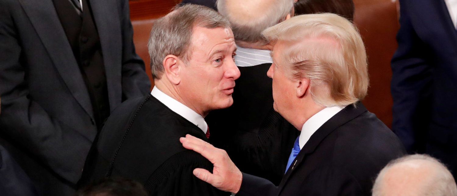 President Donald Trump talks with Chief Justice John Roberts as he departs after delivering his State of the Union address to a joint session of the U.S. Congress on Capitol Hill Jan. 30, 2018. REUTERS/Jonathan Ernst