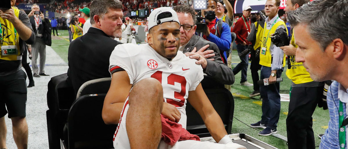 ATLANTA, GA - DECEMBER 01: Tua Tagovailoa #13 of the Alabama Crimson Tide is carted off the field after defeating the Georgia Bulldogs 35-28 in the 2018 SEC Championship Game at Mercedes-Benz Stadium on December 1, 2018 in Atlanta, Georgia. (Photo by Kevin C. Cox/Getty Images)