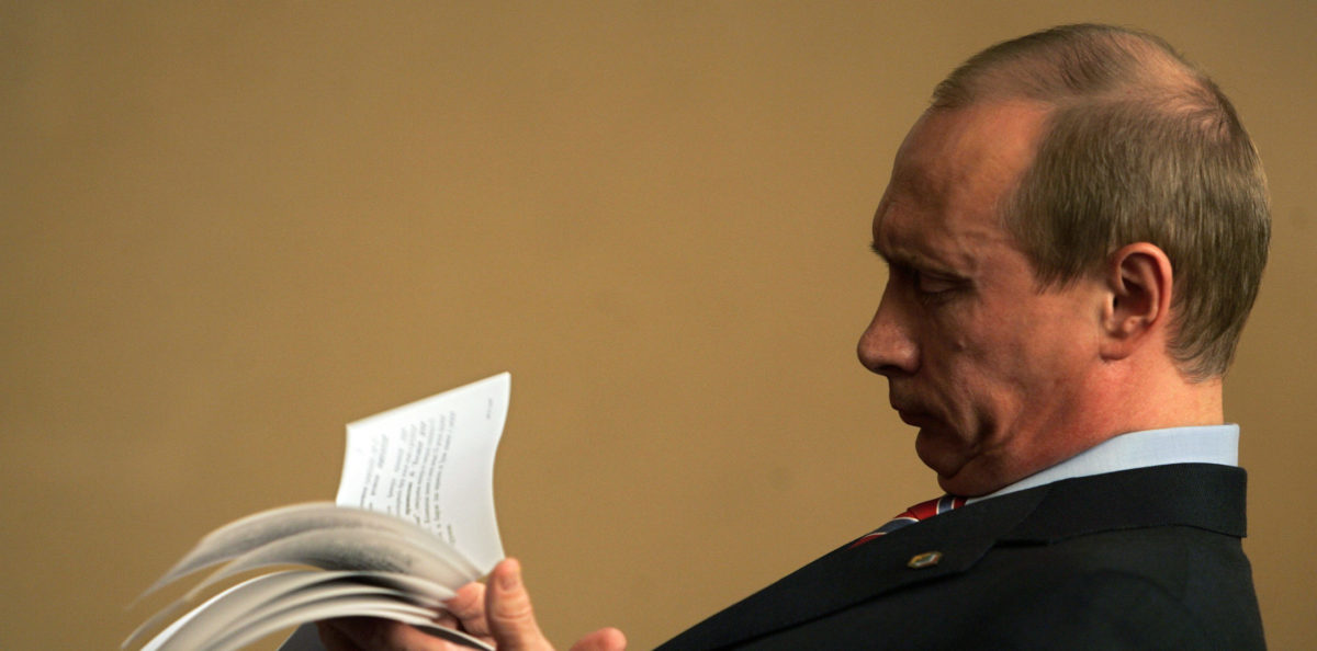 Russian President Vladimir Putin checks his notes before meeting his Serbian counterpart Boris Tadic at the sidelines of the Energy Summit of Southeast European Countries in Zagreb June 24, 2007. REUTERS/Damir Sagolj