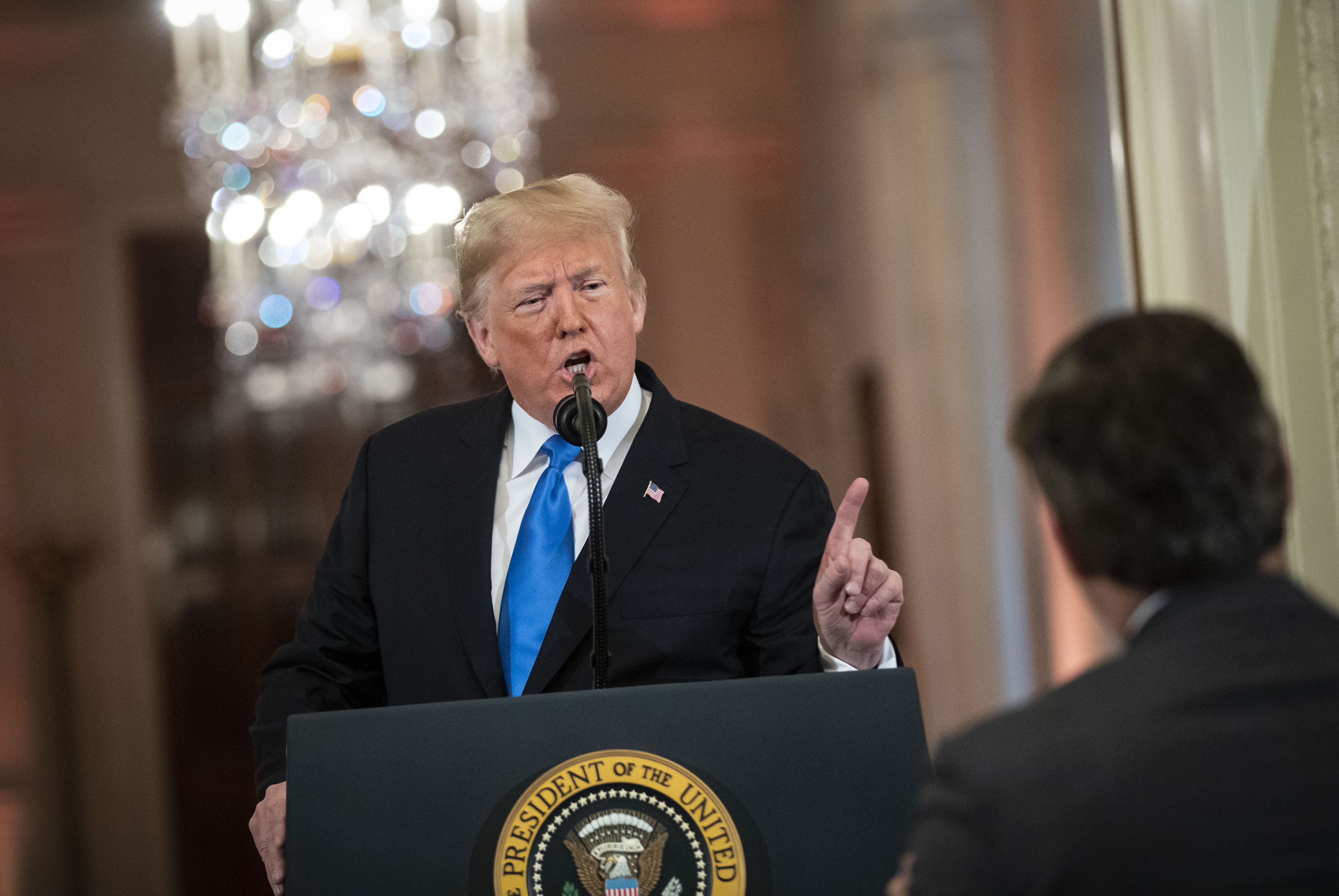 WASHINGTON, DC - NOVEMBER 07: (AFP OUT) U.S. President Donald Trump gets into an exchange with CNN reporter Jim Acosta during a news conference a day after the midterm elections on November 7, 2018 in the East Room of the White House in Washington, DC. Republicans kept the Senate majority but lost control of the House to the Democrats. Al Drago - Pool/Getty Images