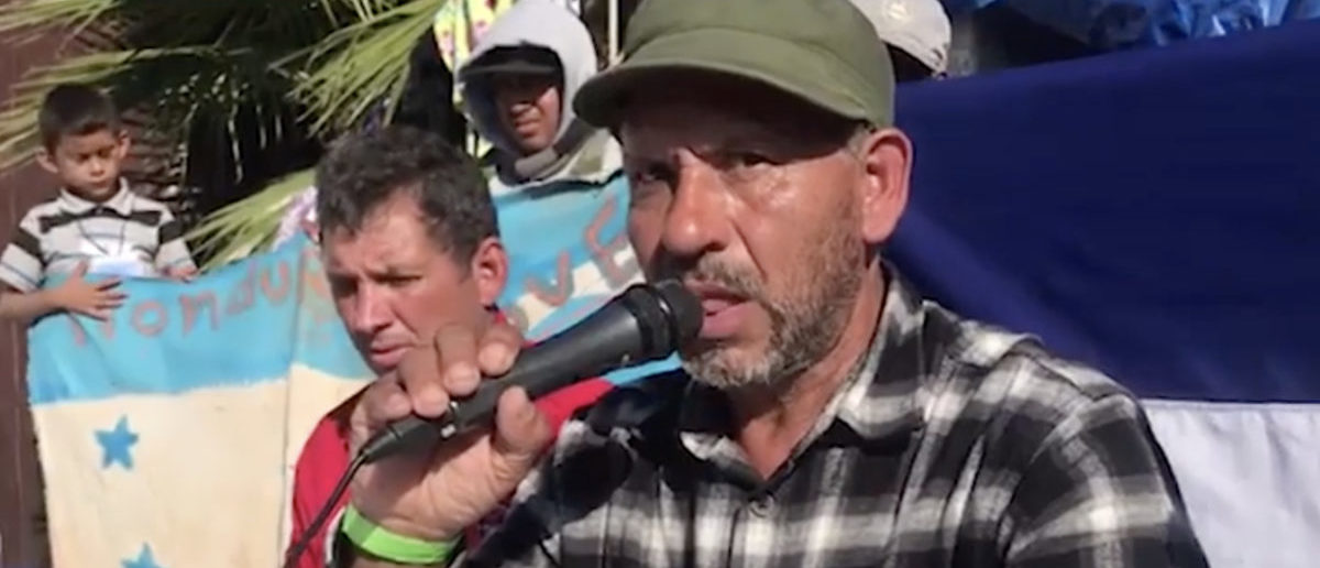 Alfonso Ulloa, a suspect in a 1987 bombing, led a group of migrants demanding entry to the United States Photo:Video screenshot/NoticiasYa