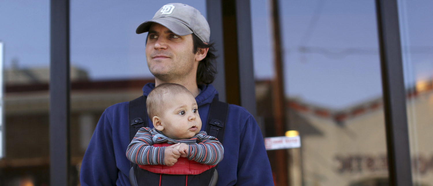 Steve Caniglia holds his six-month-old son, Boden, in San Francisco, California February 19, 2014. After tumbling more than 8 percent on the way to record lows after the 2008 financial crisis, the U.S. birth rate is expected to increase over the next two years for the first time since 2007 as young people gain more confidence to start families because of the stronger economy, demographers say. Picture taken February 19, 2014. REUTERS/Robert Galbraith