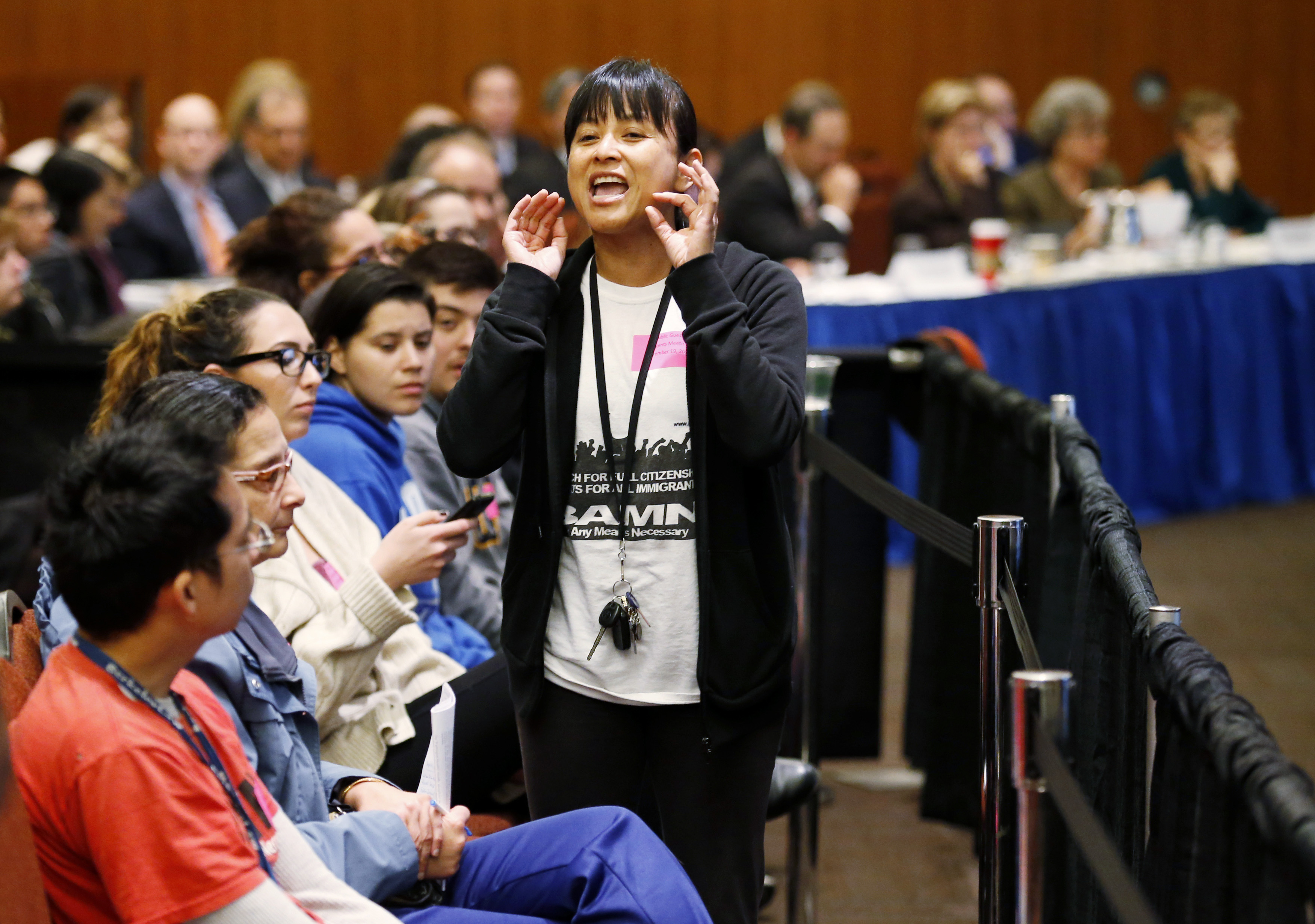 Yvette Felarca, from By Any Means Necessary, yells during the voting portion of a University of California Regents meeting, on a vote to raise tuition, at the University of California, San Francisco November 19, 2014. The University of California would raise tuition by more than 25 percent over five years under a plan passed on Wednesday by a committee of the system's governing board, a move strongly opposed by Democratic Governor Jerry Brown. The full Board of Regents will vote on Thursday on the proposal, part of an escalating and public contest of wills between Brown and Janet Napolitano, the former U.S. homeland security chief who is now the university's president. REUTERS/Beck Diefenbach