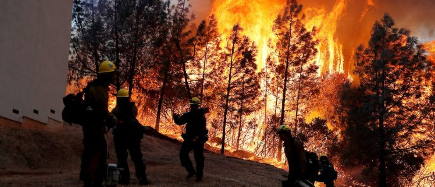 FILE PHOTO: A group of U.S. Forest Service firefighters monitor a back fire while battling to save homes at the Camp Fire in Paradise, California, U.S. November 8, 2018. REUTERS/Stephen Lam/File Photo