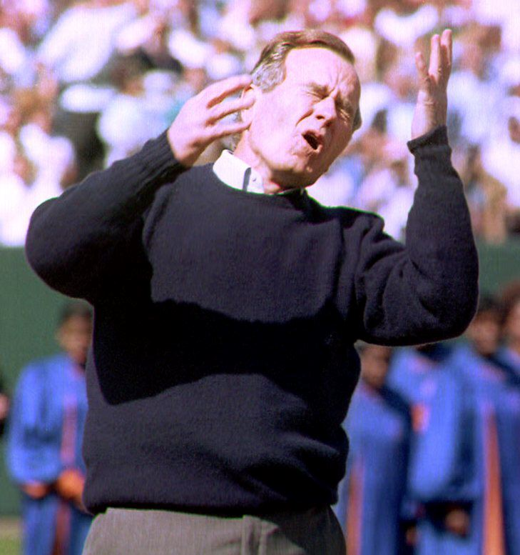 BALTIMORE, MD - APRIL 6: U.S. President George Bush reacts at his less than perfect pitch to open the baseball season 06 April 1992. President Bush threw the first pitch to open the first regular season game in the new stadium here, which is called Oriole Park at Camden Yards. The Orioles face the Cleveland Indians in the season opener. AFP (Photo credit should read ROBERT GIROUX/AFP/Getty Images)