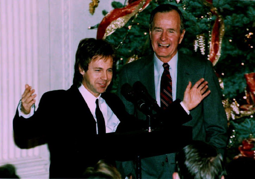 WASHINGTON, DC - DECEMBER 7: U. S. President George Bush (R) watches as comedian Dana Carvey does his George Bush impersonation 07 December 1992 Carvey and his wife Paula spent the night at the White House as guests of President Bush and First Lady Barbara Bush. (Photo credit should read ROBERT GIROUX/AFP/Getty Images)