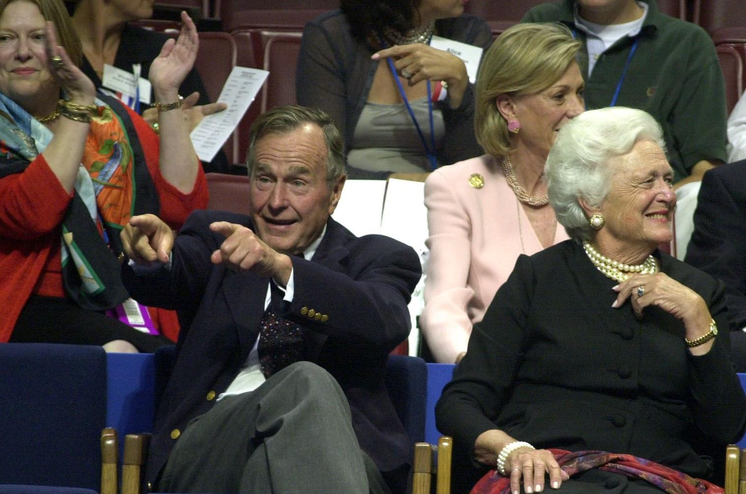 PHILADELPHIA, PA - JULY 31: Former US President George Bush (L) and his wife Barbara (R) enjoy the evening session of the 2000 Republican National Convention at the First Union Center, Philadelphia,PA, 31 July,2000. The Bush family is on hand this week to see their son, George W. Bush, receive the nomination of the Republican Party for the 2000 presidential election. (ELECTRONIC IMAGE) (Photo credit should read ROBERTO SCHMIDT/AFP/Getty Images)