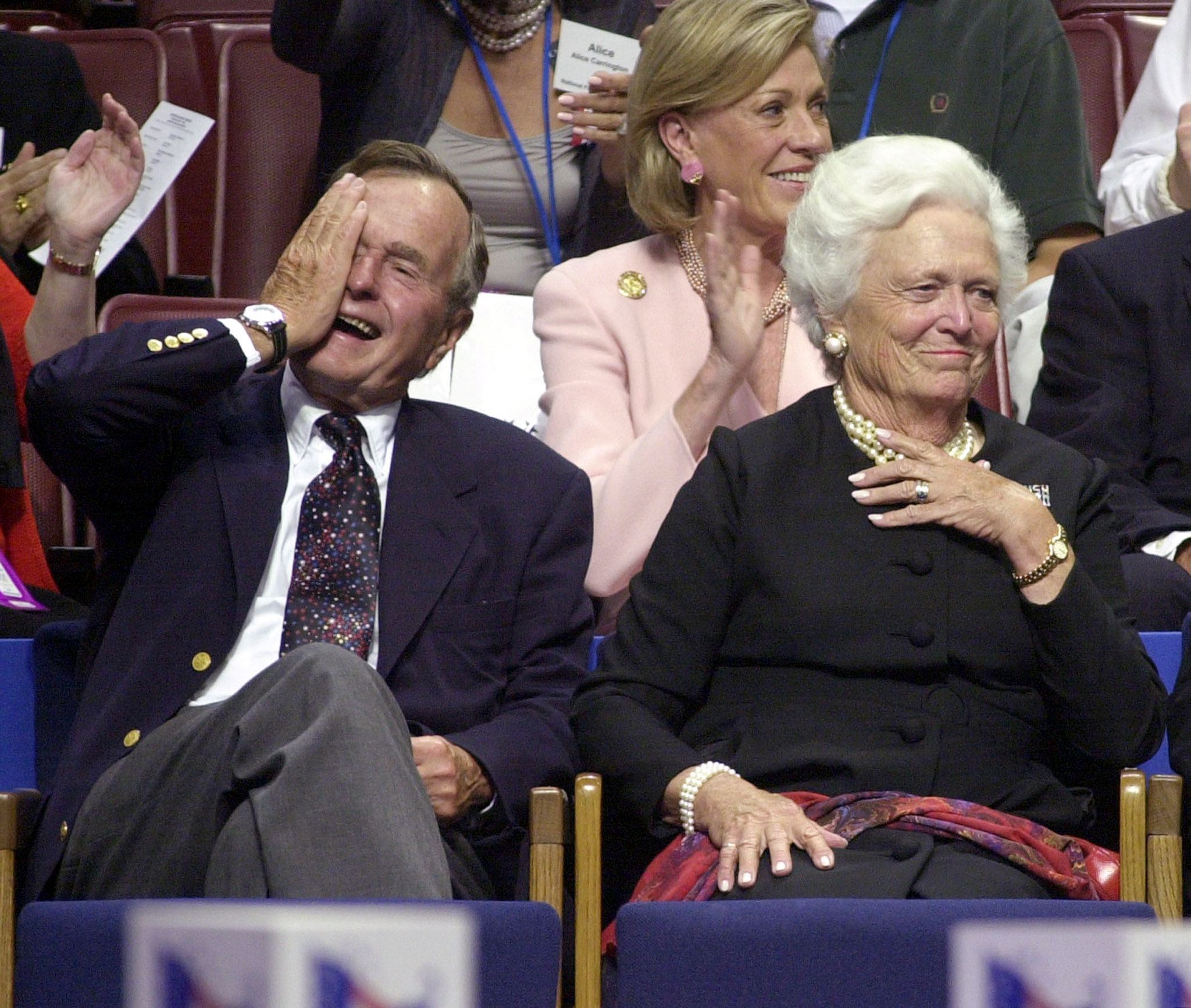 Former US President George Bush (L) and his wife Barbara laugh during the evening session of the 2000 Republican National Convention in Philadelphia's First Union Center 31 July, 2000. The Bush family is on hand this week to see their son receive the nomination of the Republican Party for the 2000 presidential election. (ELECTRONIC IMAGE) AFP PHOTO/Roberto SCHMIDT (Photo credit should read ROBERTO SCHMIDT/AFP/Getty Images)