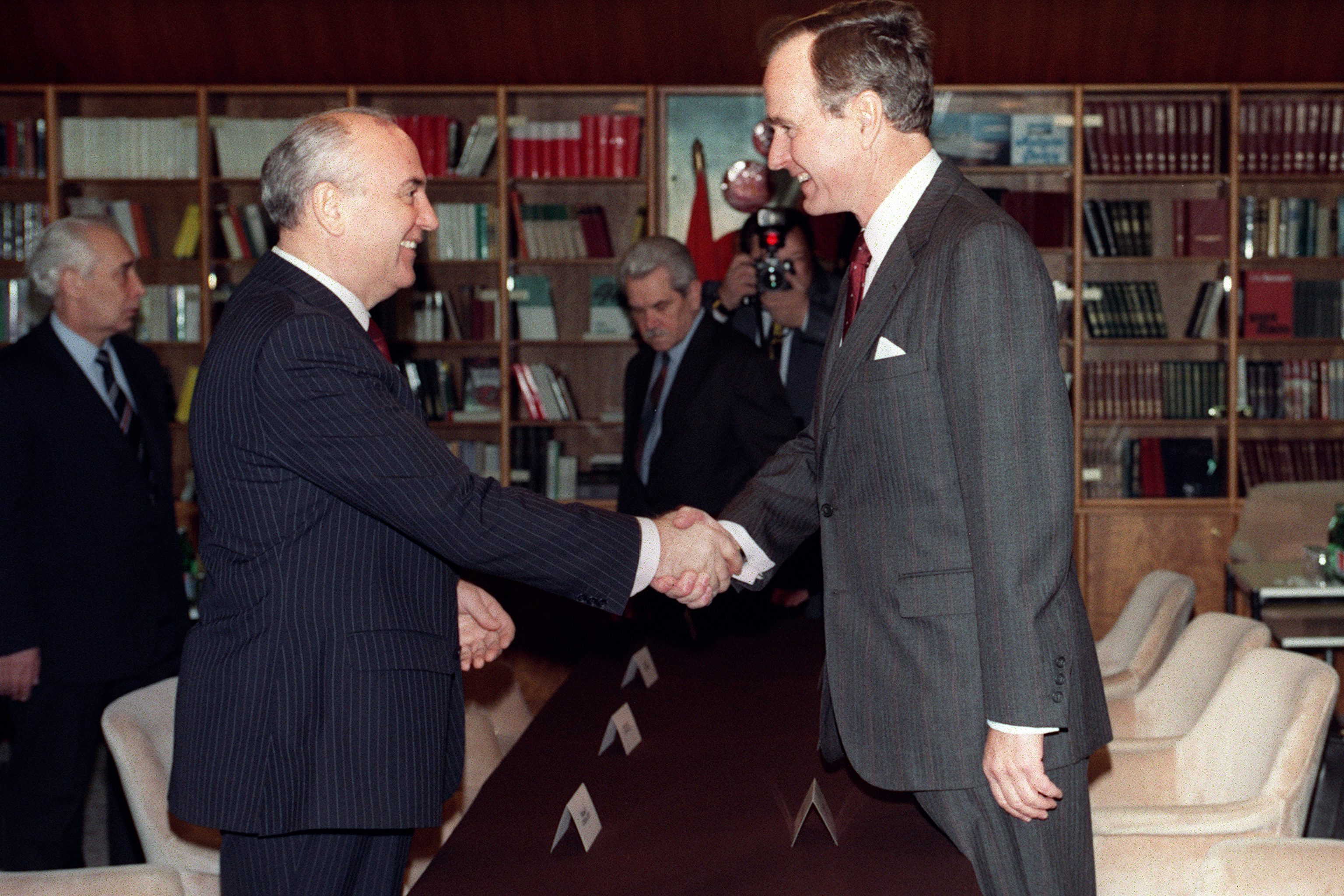 "Soviet leader Mikhail Gorbachev (L) and US President George Bush (R) shake hands on December 02, 1989 on board the soviet cruise ""Maxim Gorki"", shipdocked at Marsaxlokk harbour, before the start of their first summit meeting, just a few weeks after the fall of the Berlin Wall. This summit is viewed as the official end of the Cold War. (Photo credit should read JONATHAN UTZ/AFP/Getty Images)"