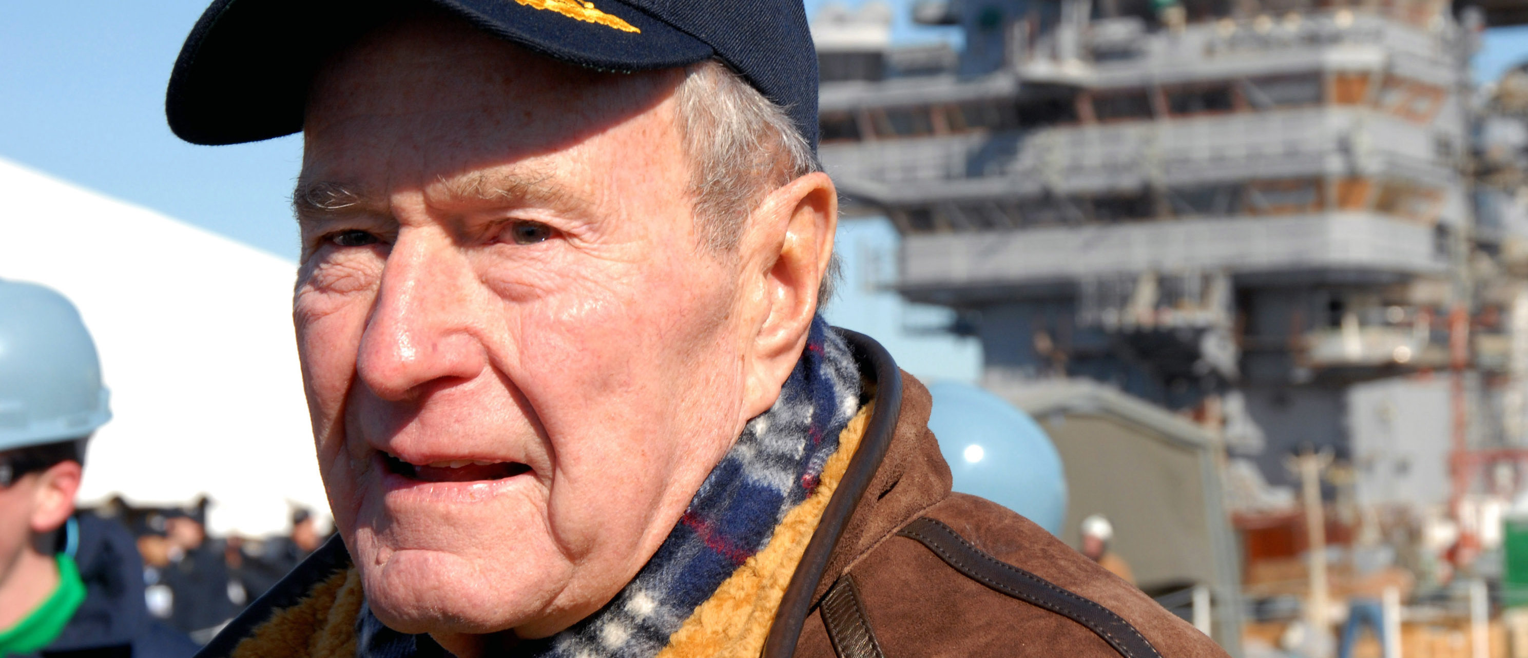 NEWPORT NEWS, VA - JANUARY 25: In this handout provided by the U.S. Navy, former U.S. President George H. W. Bush looks down the flight deck of the Precommissioning Unit (PCU) George H.W. Bush (CVN 77) during the ship's catapult testing ceremony January 25, 2008 in Newport, Virginia. Narina Reynoso/U.S. Navy via Getty Images