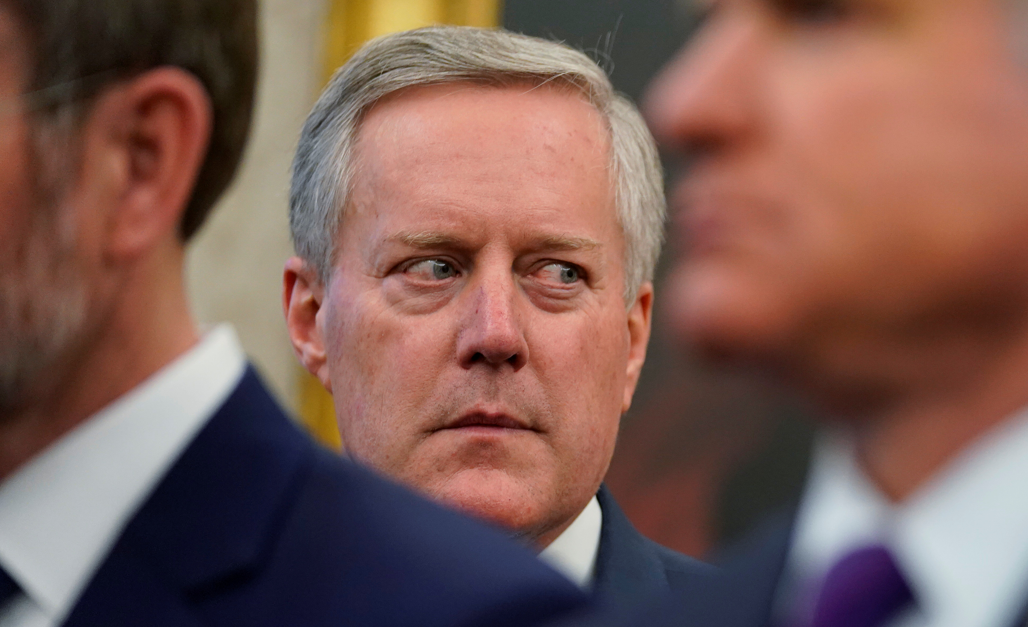 Rep. Mark Meadows (R-NC), reported to be under consideration to be U.S. President Donald Trump's next White House Chief of Staff, watches as the president talks to reporters after signing the Iraq and Syria Genocide Relief and Accountability Act of 2018 in the Oval Office at the White House in Washington, U.S. December 11, 2018. REUTERS/Jonathan Ernst