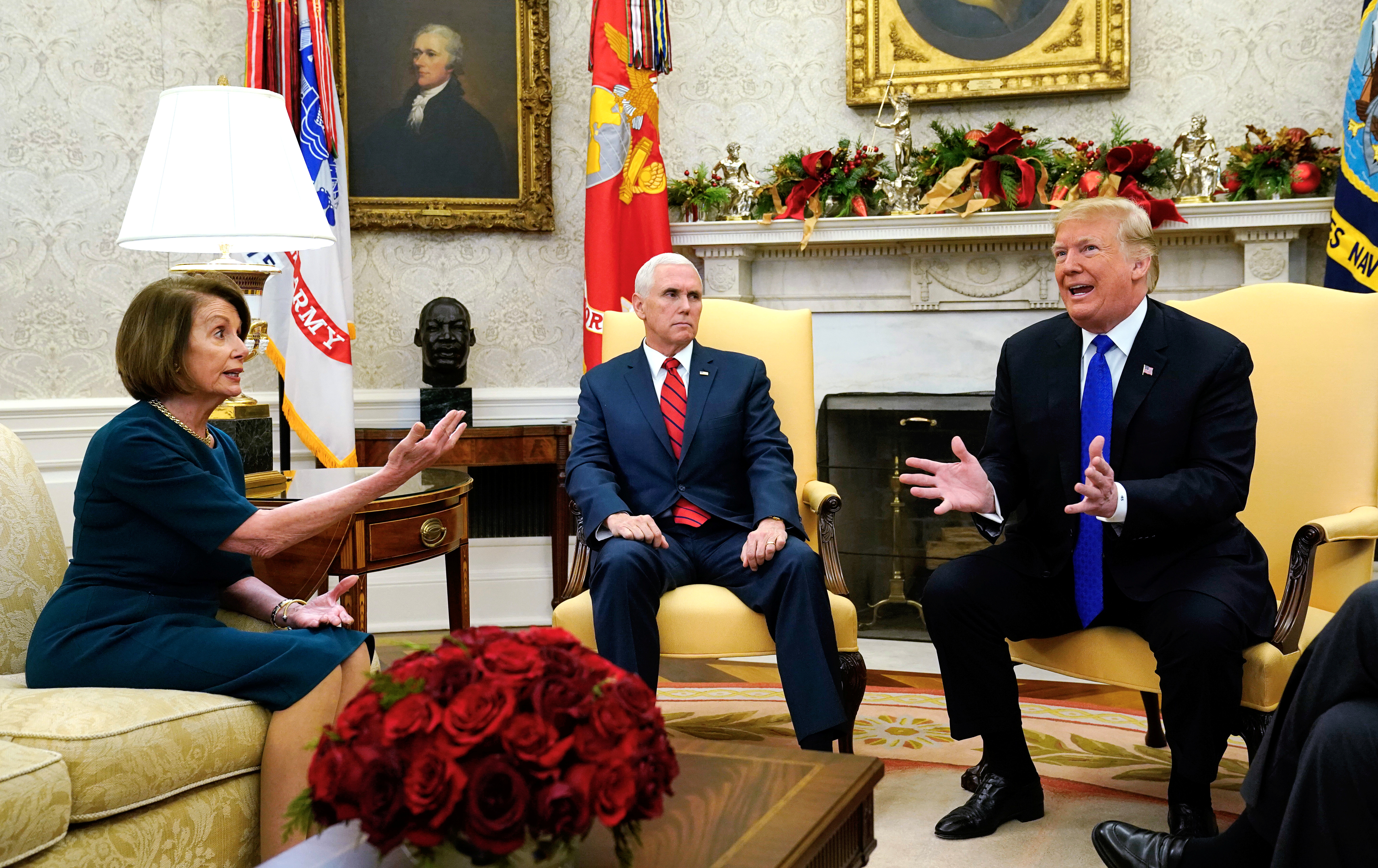 U.S. House Speaker designate Nancy Pelosi (D-CA) speaks with Vice President Mike Pence and U.S. President Donald Trump as they meet with her and Senate Minority Leader Chuck Schumer (D-NY) in the Oval Office at the White House in Washington, U.S., December 11, 2018. REUTERS/Kevin Lamarque