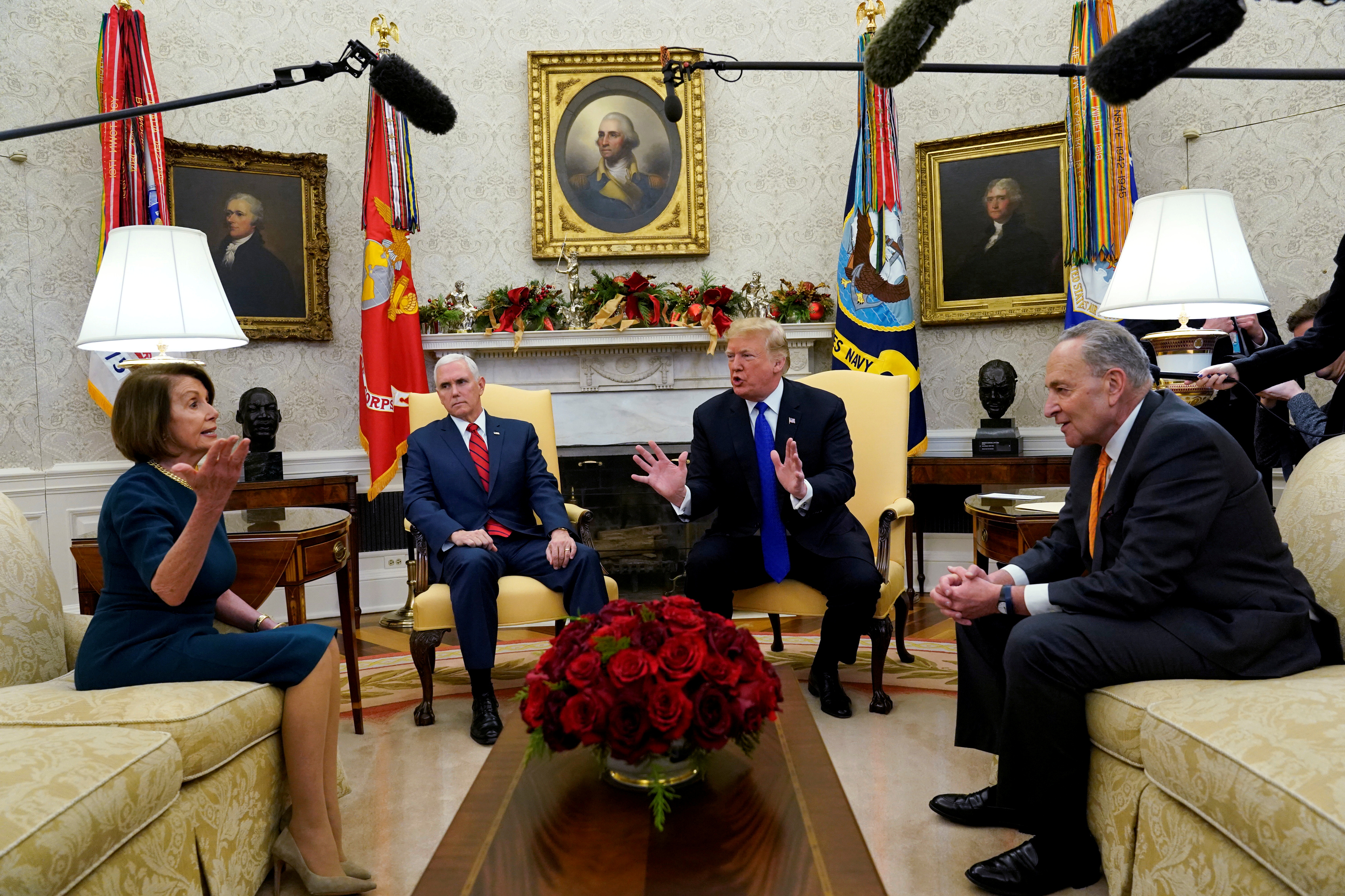 President Donald Trump speaks next to Vice President Mike Pence while meeting with Senate Democratic Leader Chuck Schumer and House Minority Leader Nancy Pelosi at the White House in December 11, 2018. REUTERS/Kevin Lamarque