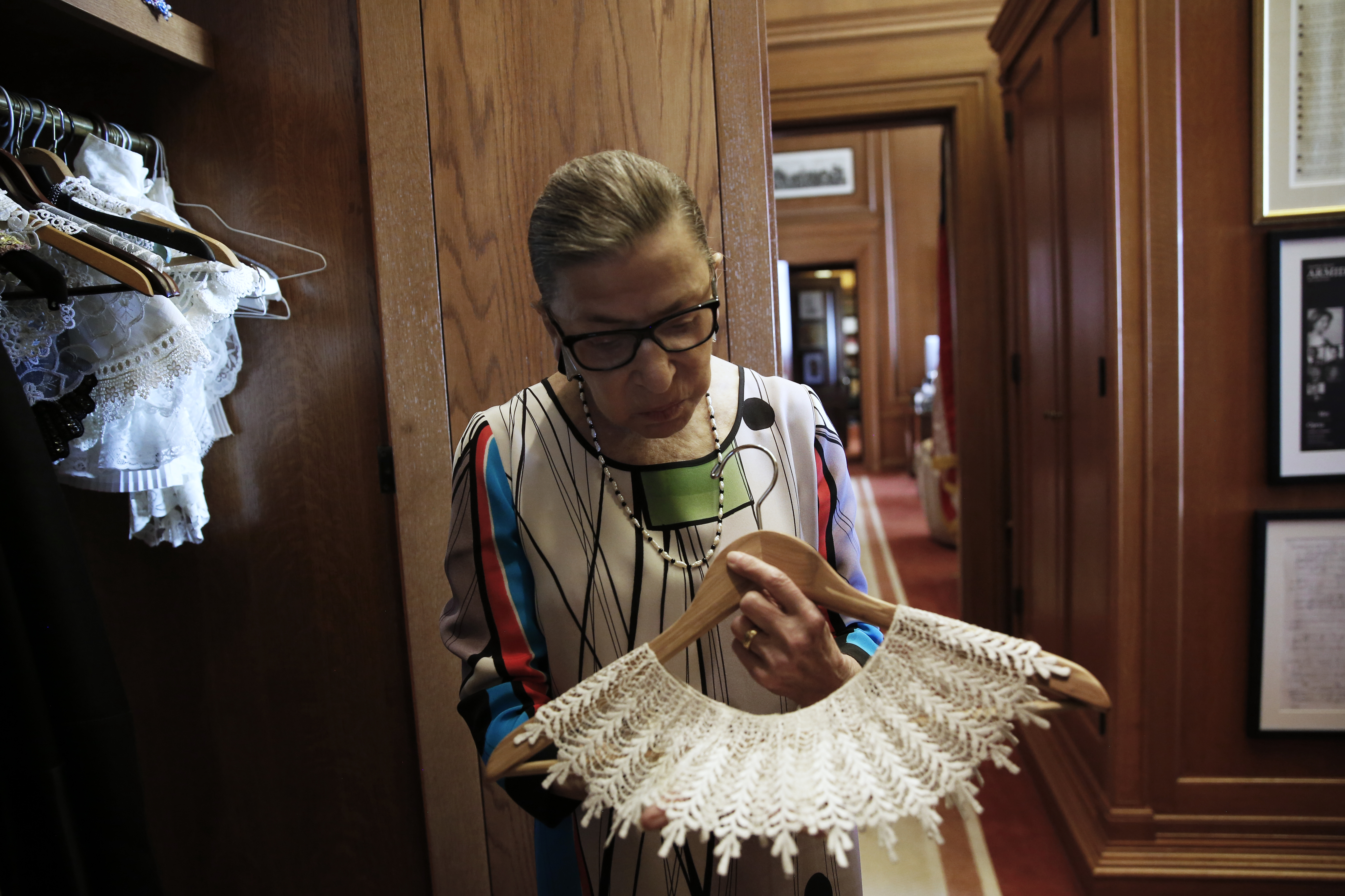 U.S. Supreme Court Justice Ruth Bader Ginsburg shows the many different collars (jabots) she wears with her robes, in her chambers at the Supreme Court building in Washington, U.S. June 17, 2016. REUTERS/Jonathan Ernst