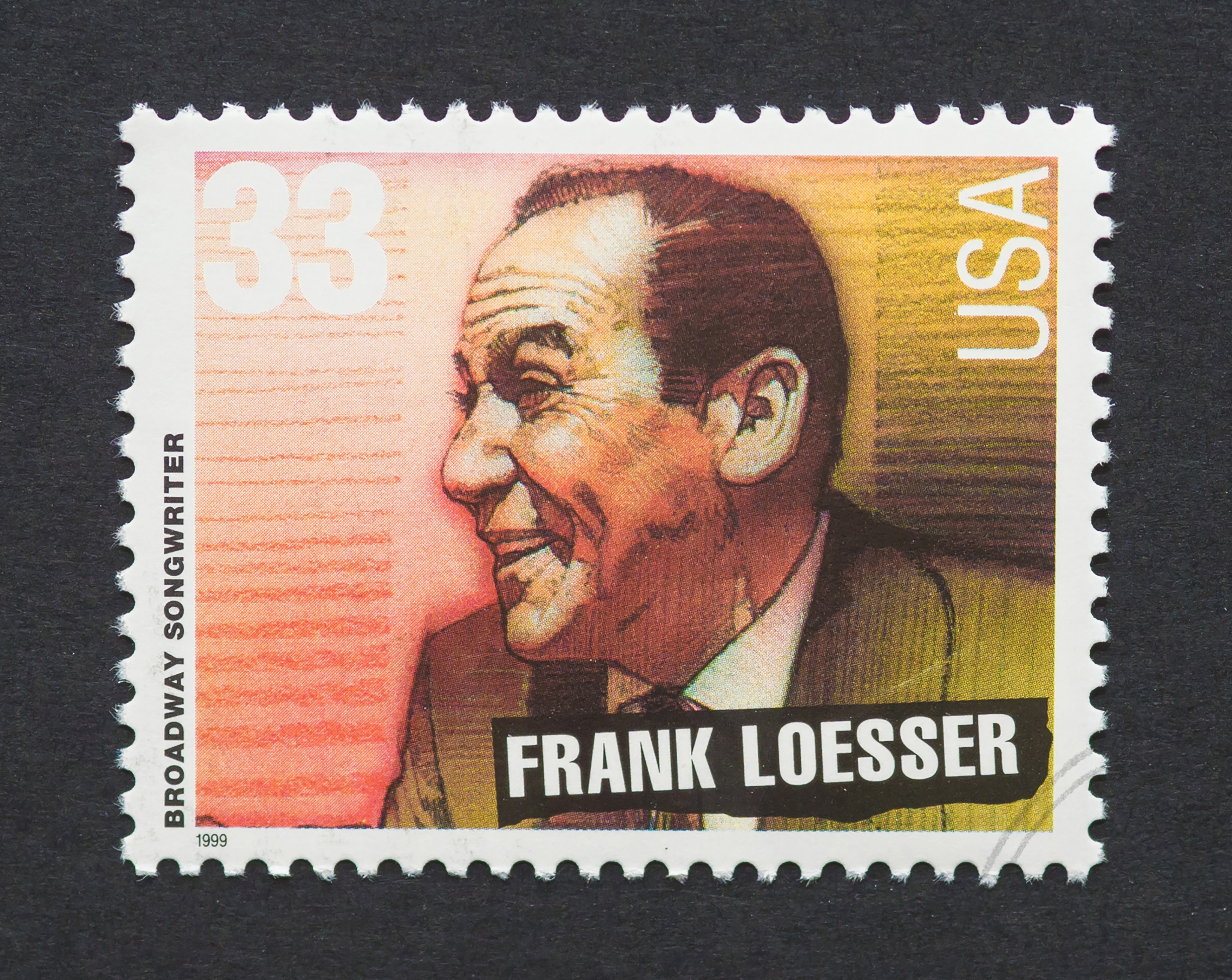 Broadway songwriter Frank Loesser's likeness appears on a postage stamp. Shutterstock image via user catwalker