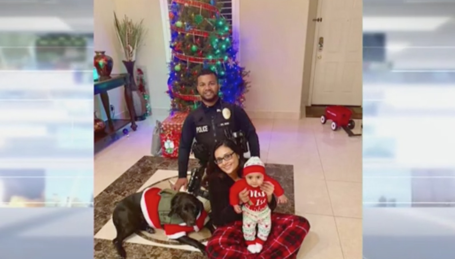 Officer Ronil Singh with his canine partner Sam, his wife, and five-month-old son. Screens Shot/Fox News