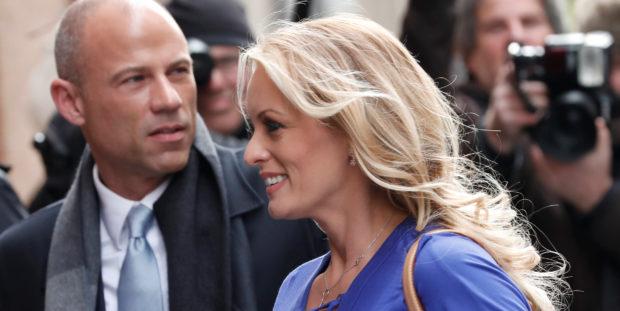 Adult-film actress Stephanie Clifford, also known as Stormy Daniels, arrives with her attorney Michael Avenatti (L) at ABC studios to appear on The View talk show in New York City, New York, U.S. April 17, 2018. REUTERS/Mike Segar