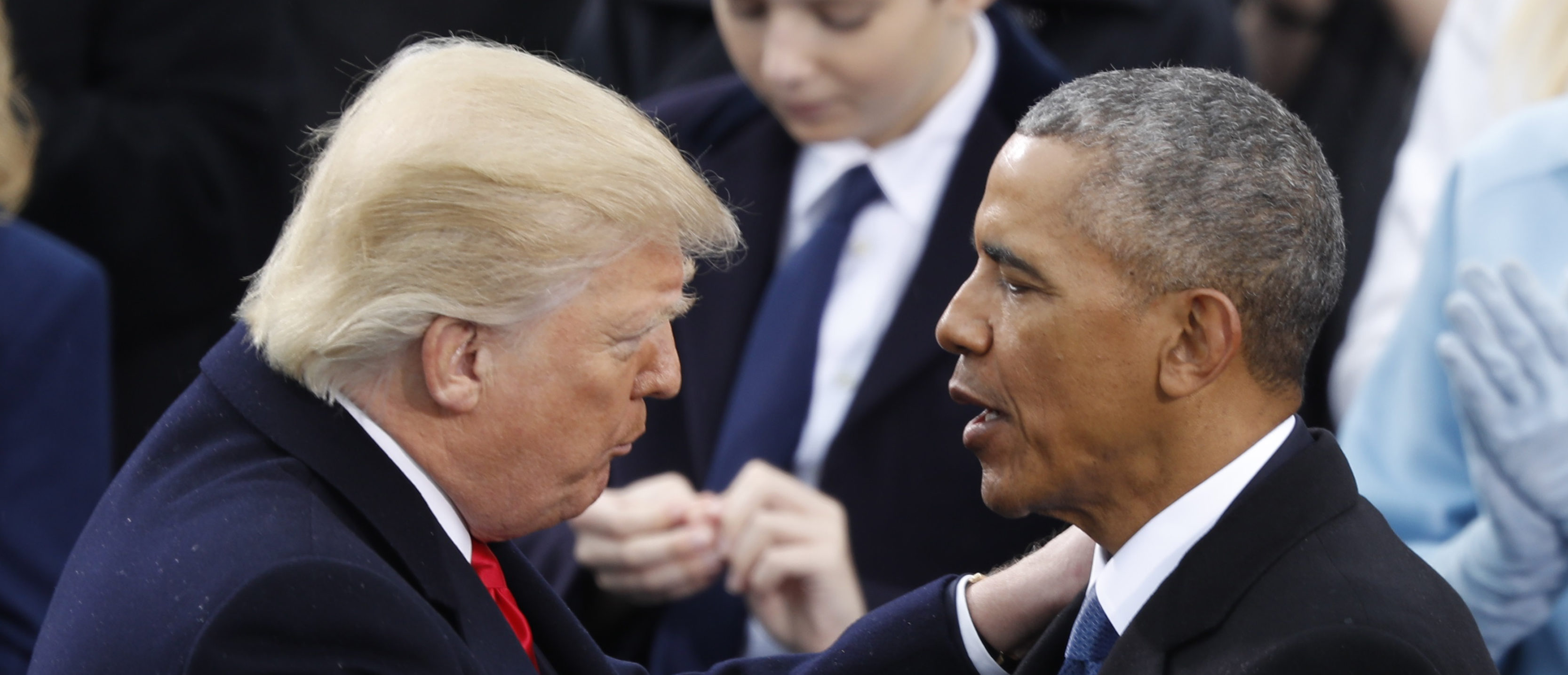 U.S. President Donald Trump (L) greets former President Barack Obama after being sworn in as the 45th president of the United States on the West front of the U.S. Capitol in Washington, U.S., January 20, 2017. REUTERS/Lucy Nicholson