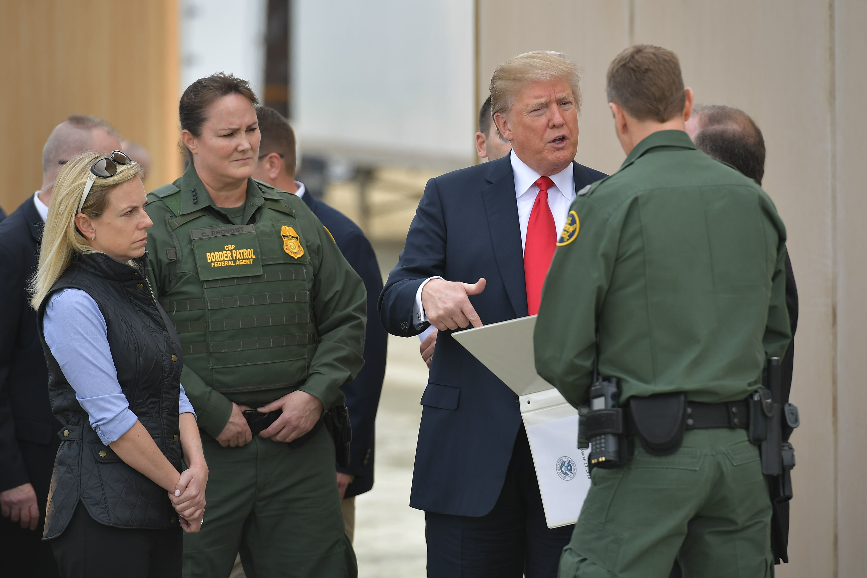 US President Donald Trump is shown border wall prototypes in San Diego, California on March 13, 2018. (Mandel Ngan/AFP/Getty Images)