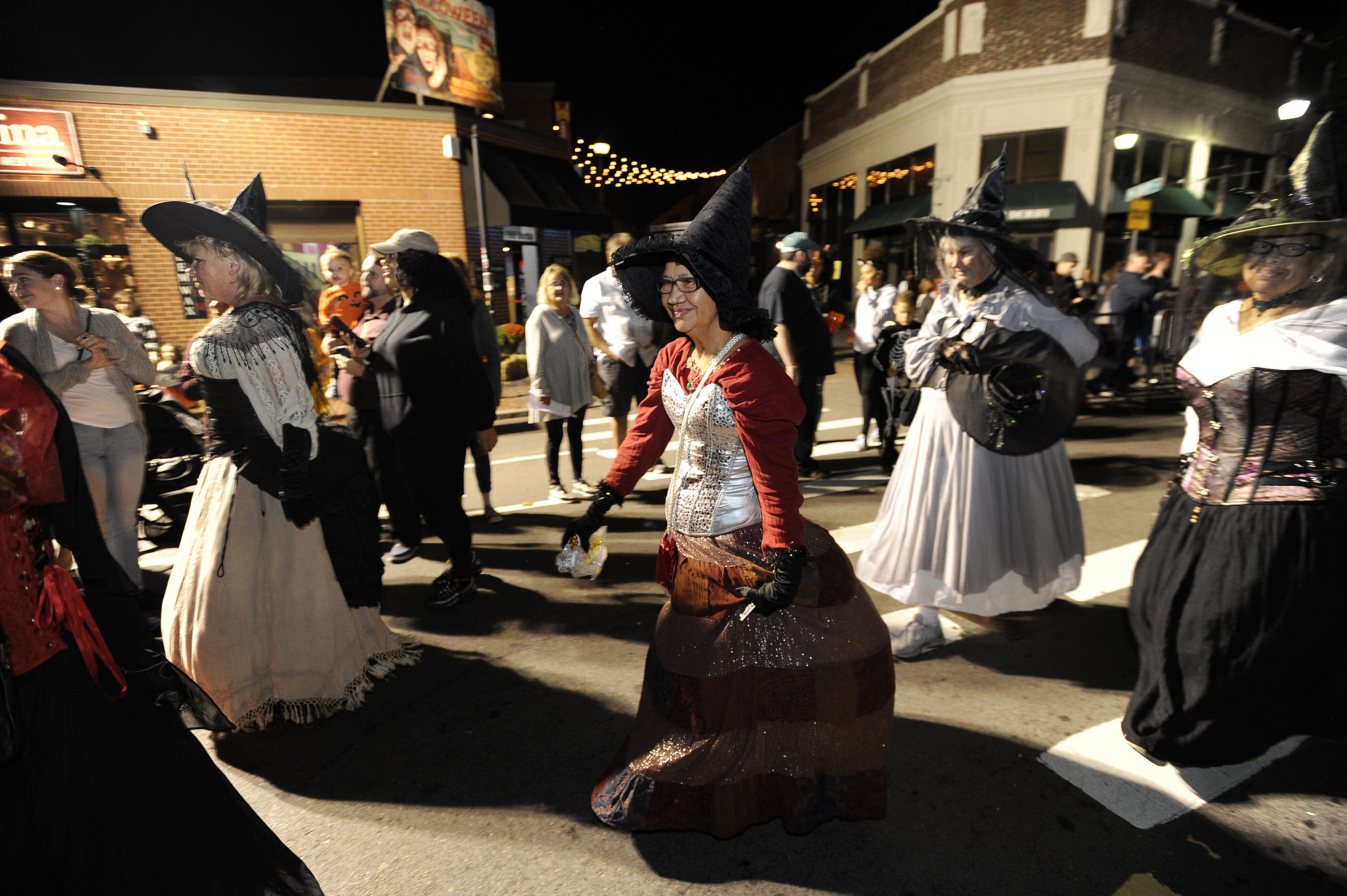 Witches make their way down the parade route during the 23rd Annual Salem Chamber of Commerce Haunted Happenings Grand Parade, which launches the Halloween season in Salem, Massachusetts, on October 4, 2018. JOSEPH PREZIOSO/AFP/Getty Images