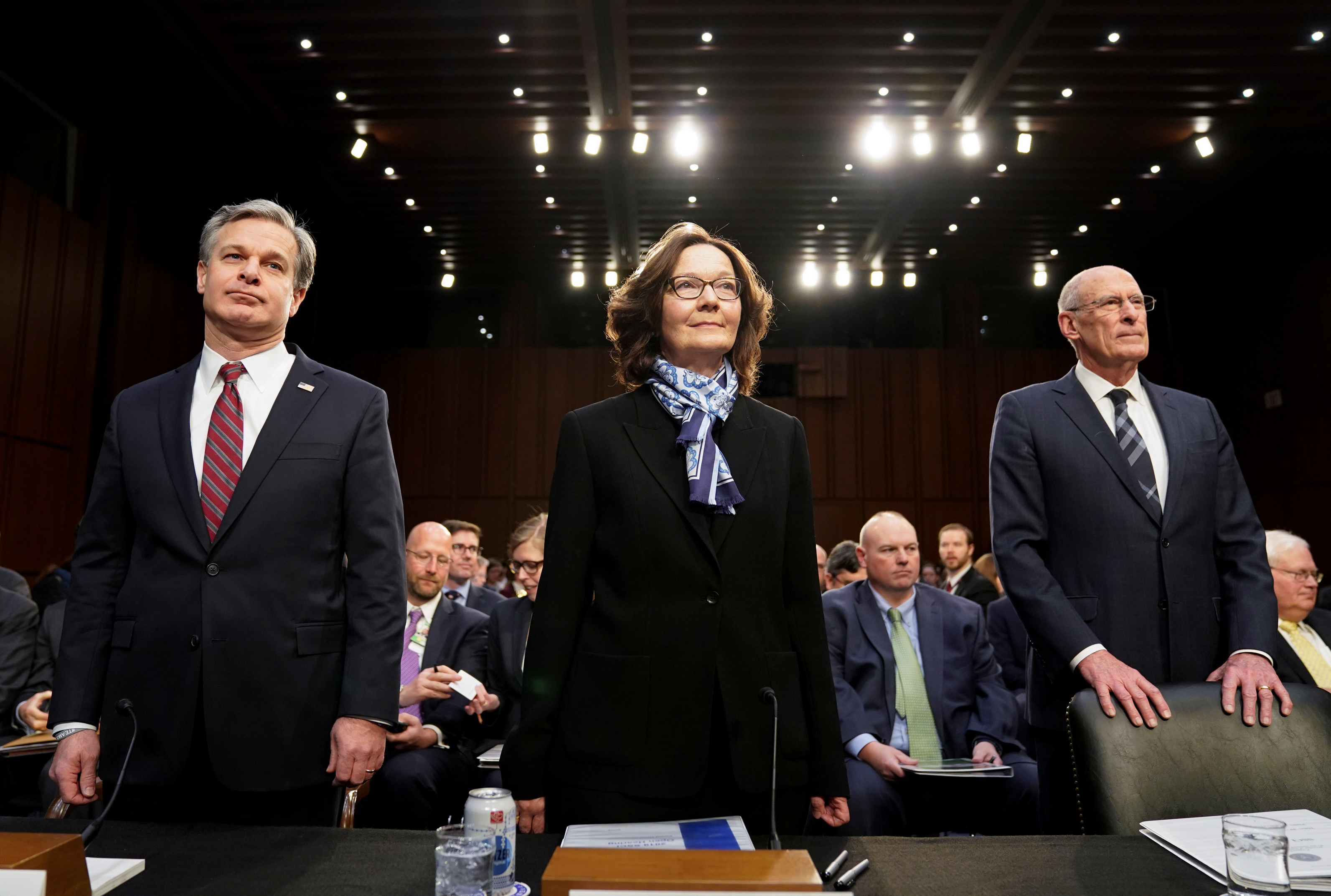 "FBI Director Christopher Wray; CIA Director Gina Haspel and Director of National Intelligence Dan Coats arrive with other U.S. intelligence community officials to testify before a Senate Intelligence Committee hearing on ""worldwide threats"" on Capitol Hill in Washington, U.S., Jan. 29, 2019. REUTERS/Joshua Roberts"