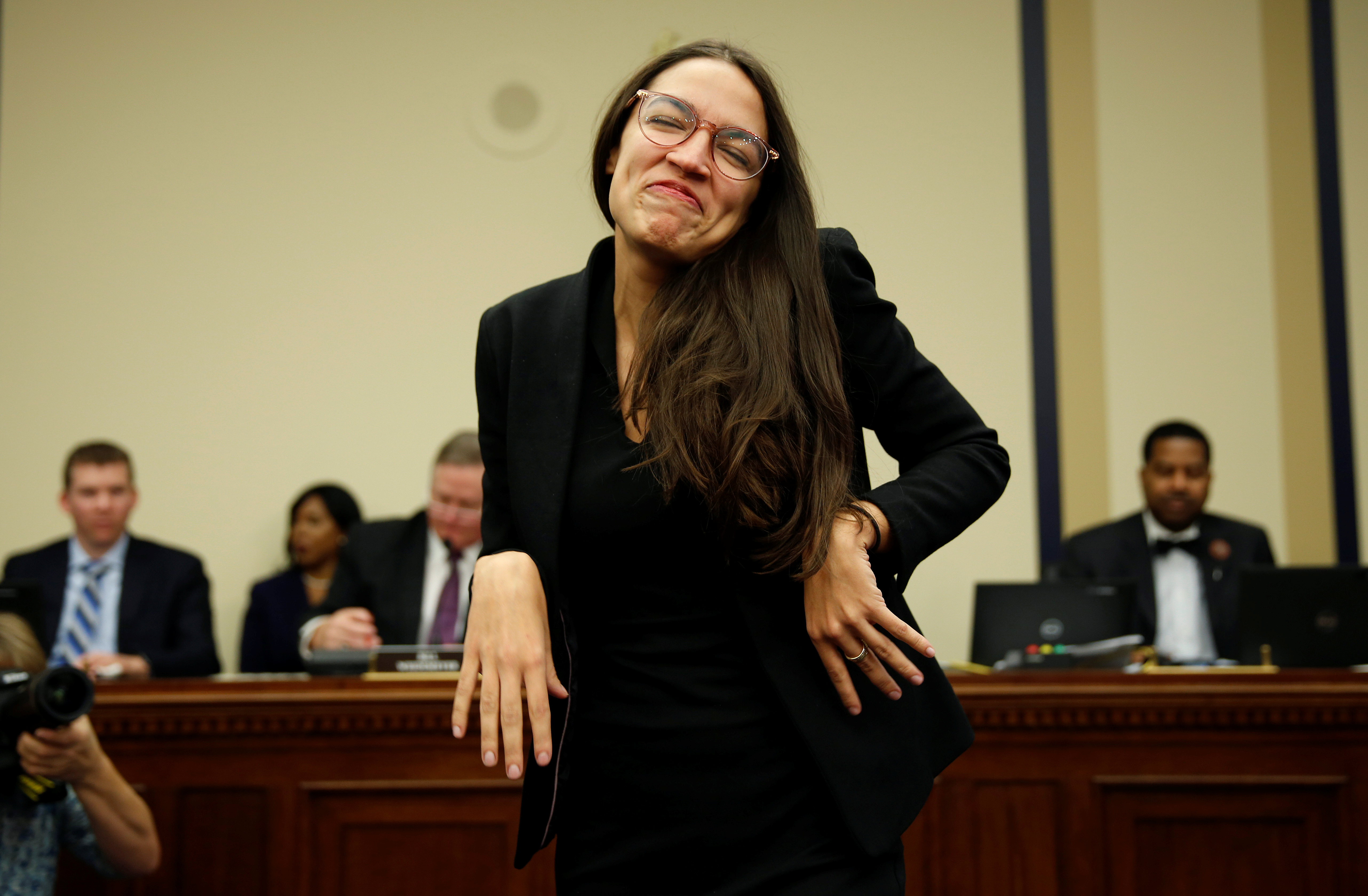 Representative-elect Alexandria Ocasio Cortez (D-NY) reacts to drawing number 40 during a lottery for office assignments on Capitol Hill in Washington, U.S., November 30, 2018. REUTERS/Joshua Roberts
