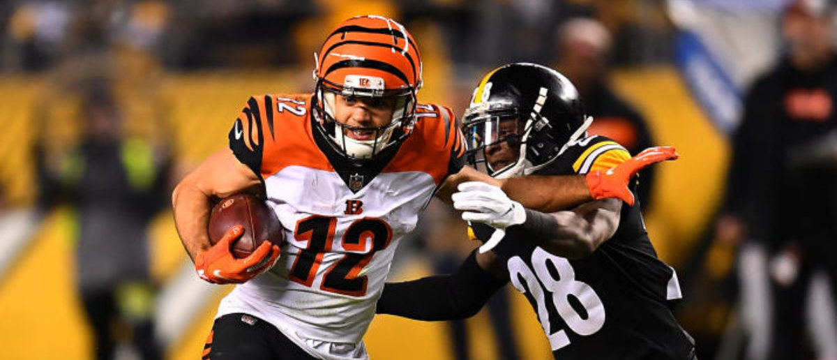 PITTSBURGH, PA - DECEMBER 30: Alex Erickson #12 of the Cincinnati Bengals runs upfield past Mike Hilton #28 of the Pittsburgh Steelers after a catch in the first half during the game at Heinz Field on December 30, 2018 in Pittsburgh, Pennsylvania. (Photo by Joe Sargent/Getty Images)