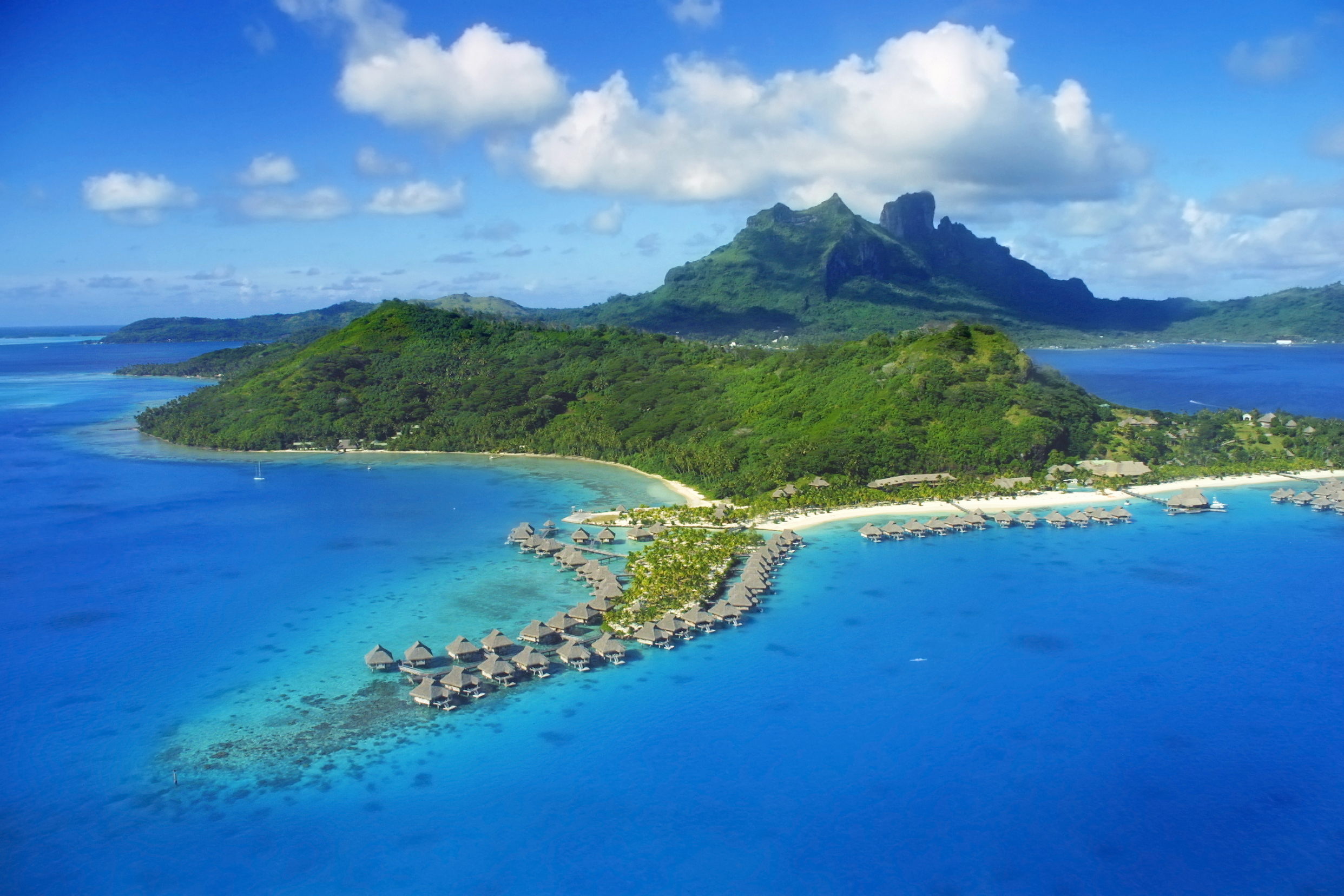 Aerial view of Bora Bora with overwater bungalows. Shutterstock/Christian Wilkinson