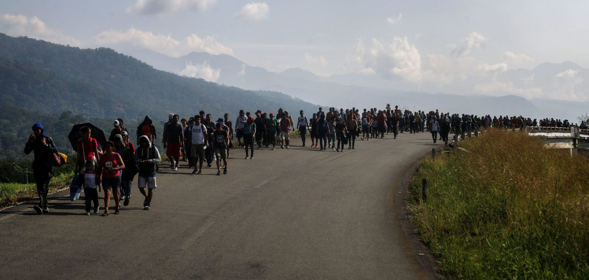 HUIXTLA, MEXICO - JANUARY 20: People from a caravan of Central American migrants walk along a highway on their way toward the United States on January 20, 2019 in Huixtla, Mexico. Some members of the caravan are in Mexico while others are further behind in Guatemala. (Photo by Mario Tama/Getty Images)