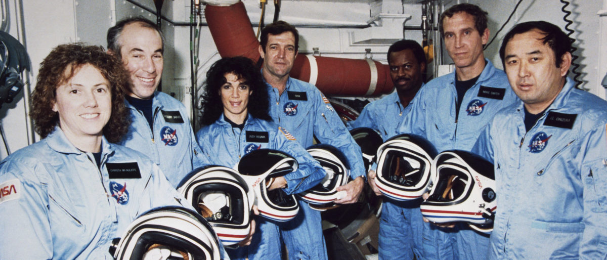 The Challenger crew takes a break during countdown training at NASA's Kennedy Space Center in this Jan. 9, 1986 NASA file photograph. (REUTERS/NASA/Handout)