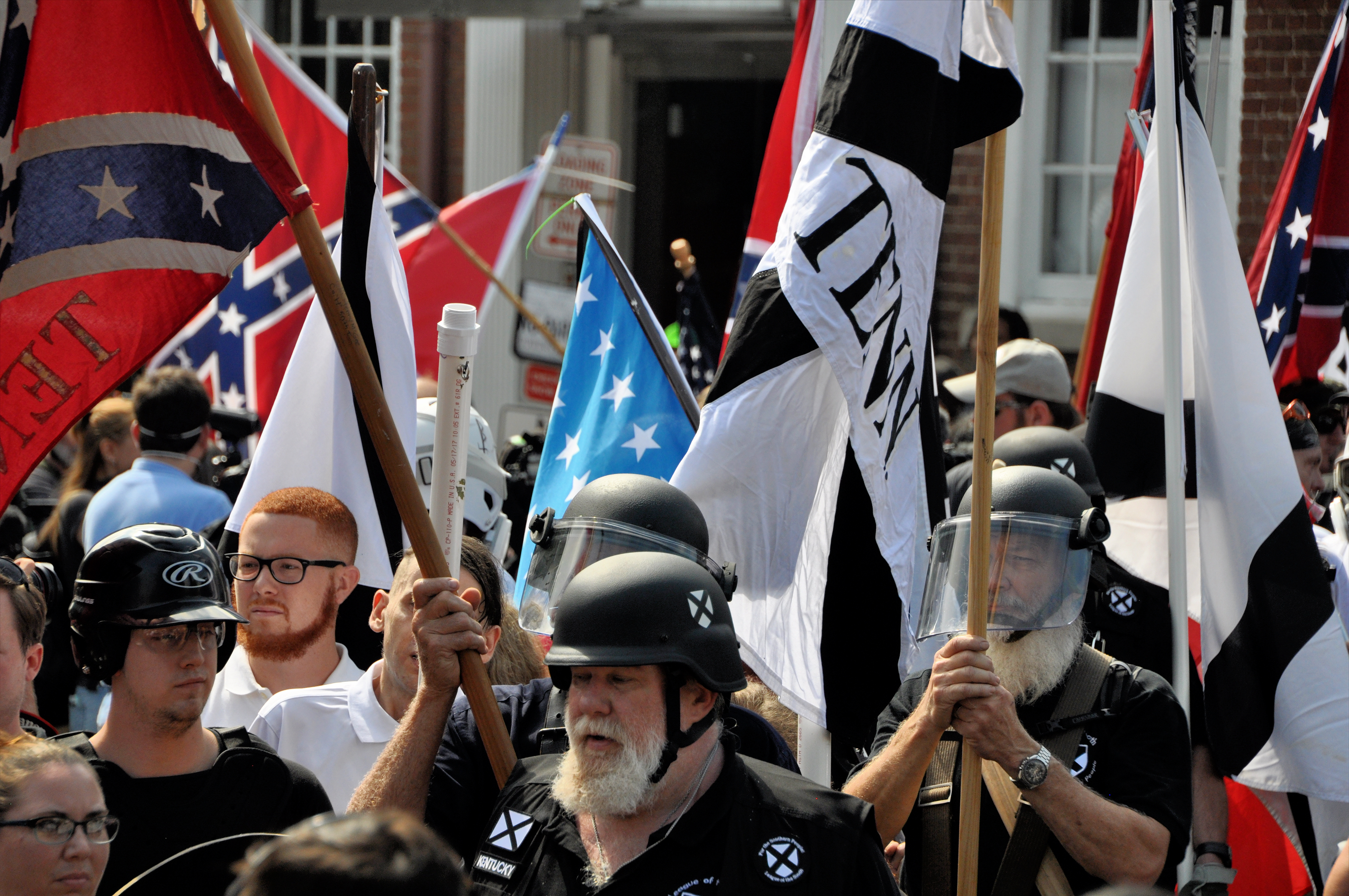 CHARLOTTESVILLE, VA - August 12, 2017: White nationalists and counter protesters clash in during a rally that turned violent resulting in the death of one and multiple injuries. SHUTTERSTOCK/ Kim Kelley-Wagner