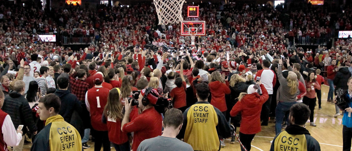 MADISON, WISCONSIN - JANUARY 19: Fans rush the court after the Wisconsin Badgers beat the Michigan Wolverines 64-54 at the Kohl Center on January 19, 2019 in Madison, Wisconsin. (Photo by Dylan Buell/Getty Images)