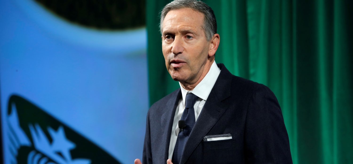 FILE PHOTO: Starbucks Chairman and CEO Howard Schultz delivers remarks at the Starbucks 2016 Investor Day in Manhattan, New York, U.S. December 7, 2016. REUTERS/Andrew Kelly/File Photo