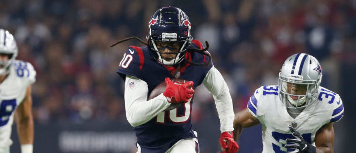 HOUSTON, TX - OCTOBER 07: DeAndre Hopkins #10 of the Houston Texans runs after a catch pursued by Byron Jones #31 of the Dallas Cowboys in the first quarter at NRG Stadium on October 7, 2018 in Houston, Texas. (Photo by Tim Warner/Getty Images)