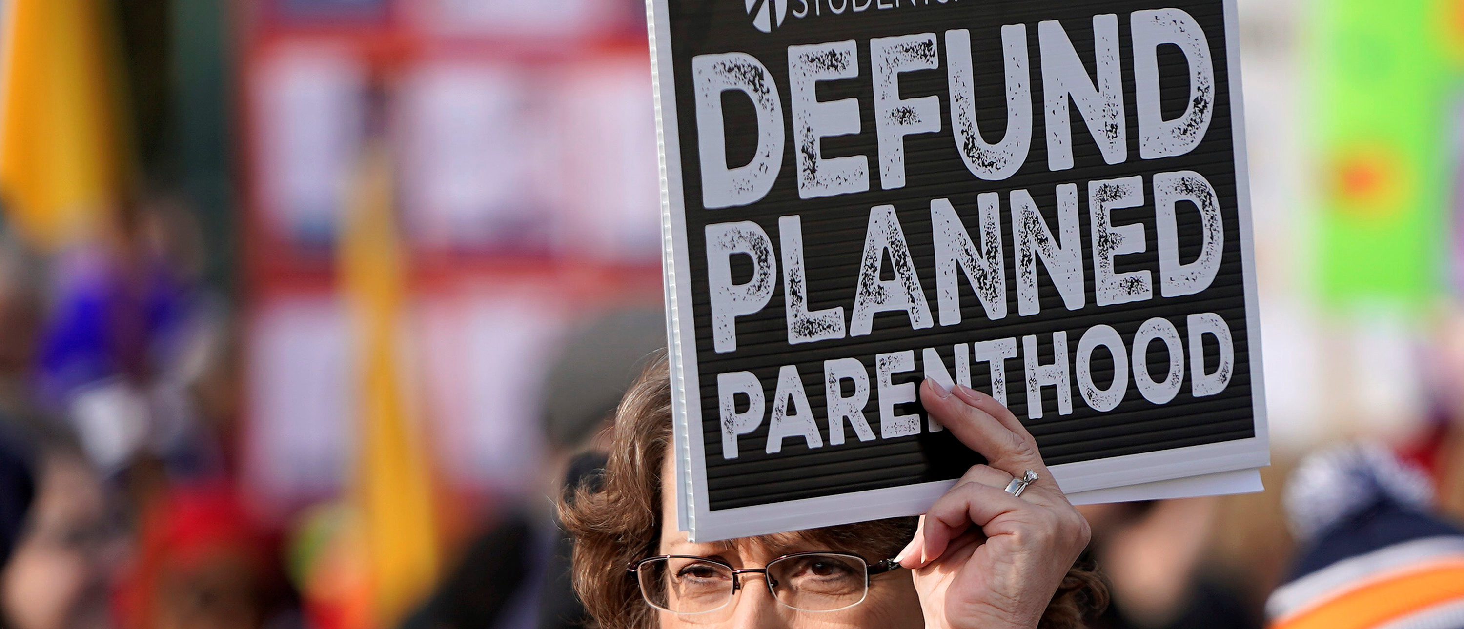 An anti-abortion marcher carries a sign calling for the organisation Planned Parenthood to loose funding, during in the 46th annual March for Life at the Supreme Court in Washington, U.S., January 18, 2019. REUTERS/Joshua Roberts
