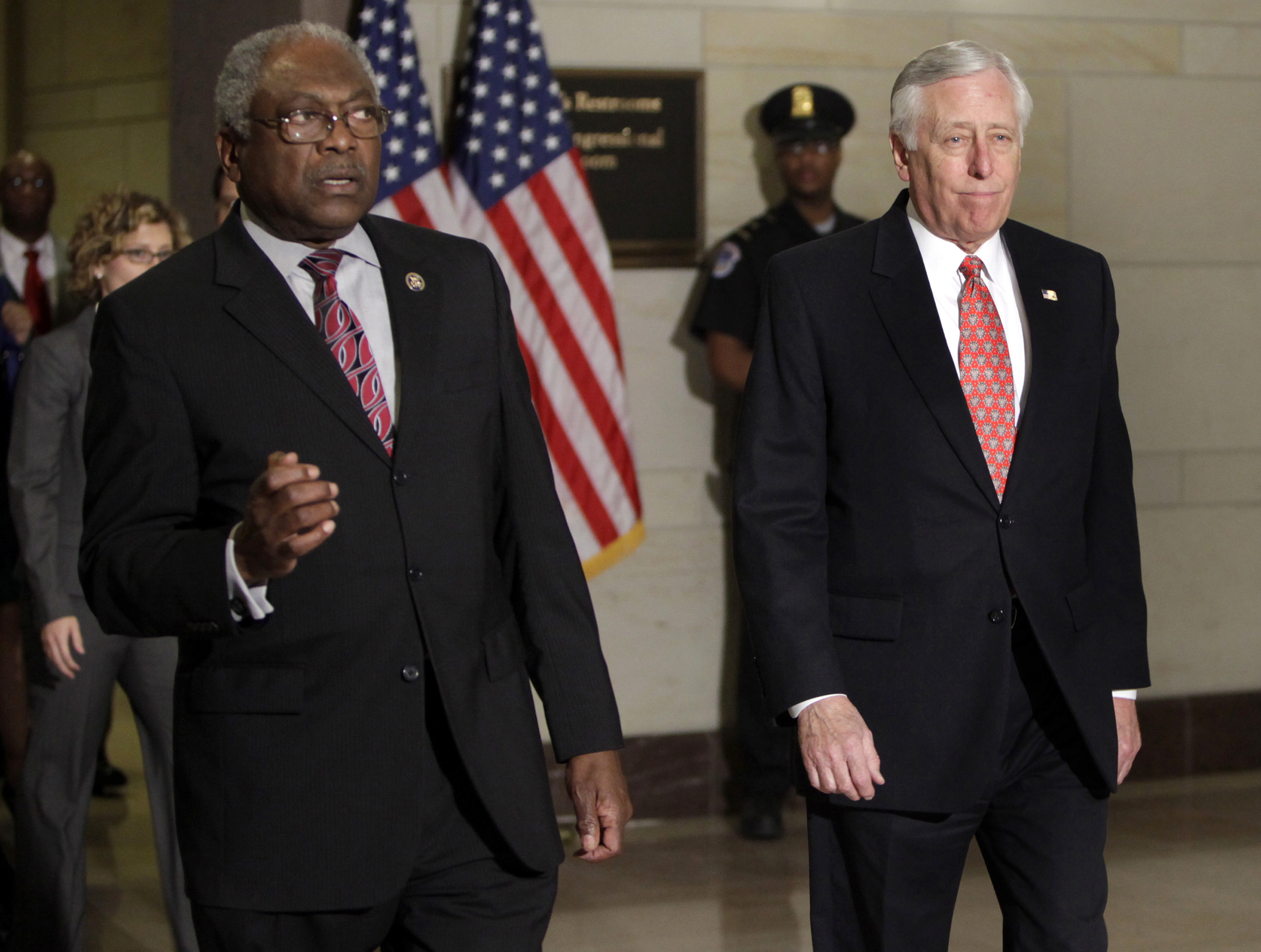 House Majority Leader Steny Hoyer and House Majority Whip James Clyburn arrive at President Barack Obama's meeting REUTERS/Yuri Gripas