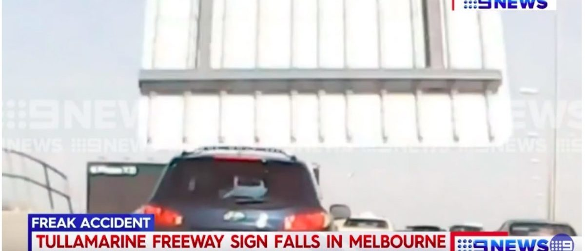 Woman Gets Quite The Surprise When She's Driving Down The Road And A Freeway Sign Breaks Loose
