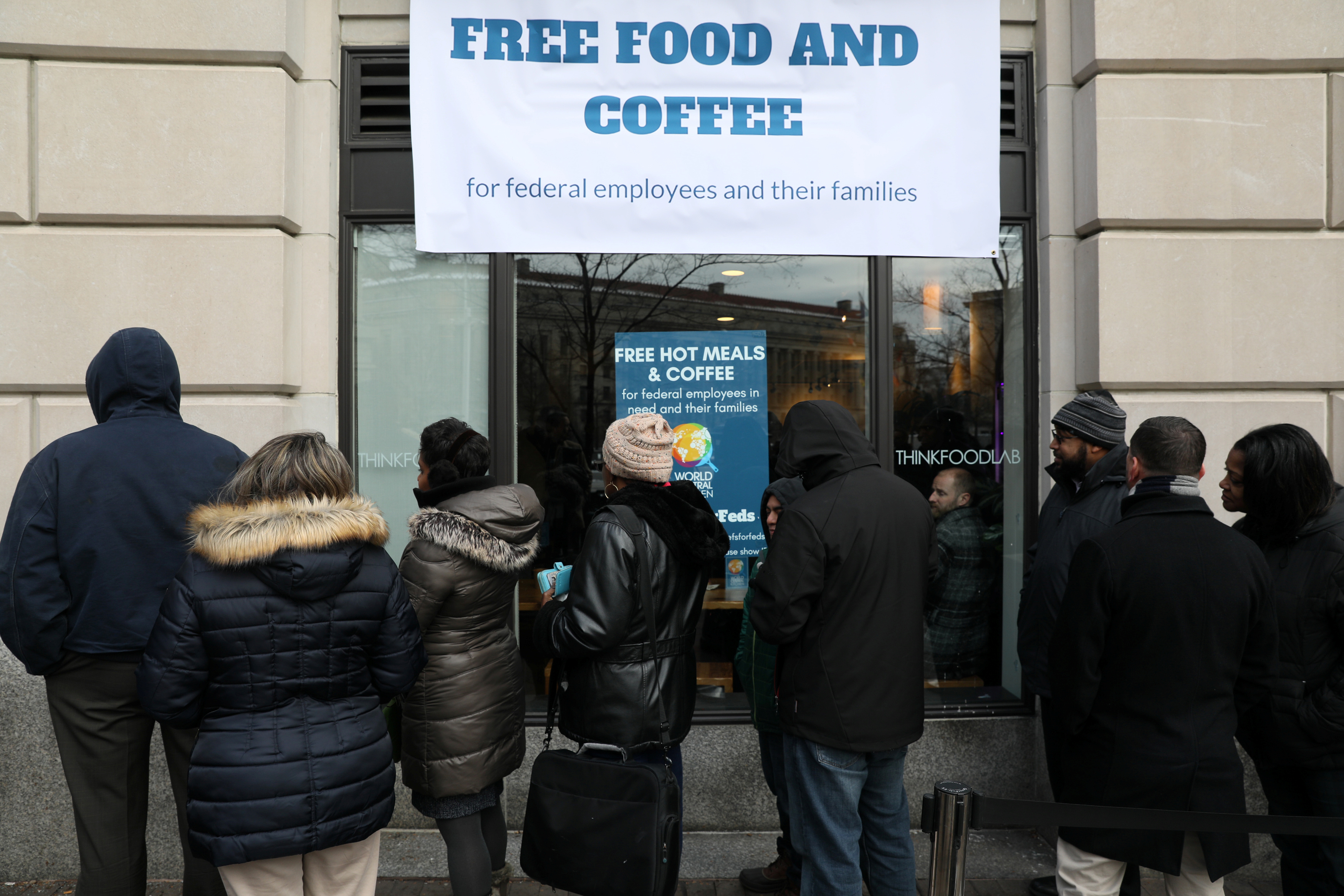 Federal workers left unpaid or furloughed by the extended partial government shutdown stand in line for fresh food and coffee at the World Central Kitchen, a volunteer emergency kitchen run by Chef Jose Andres, in Washington, U.S. January 16, 2019. REUTERS/Jonathan Ernst