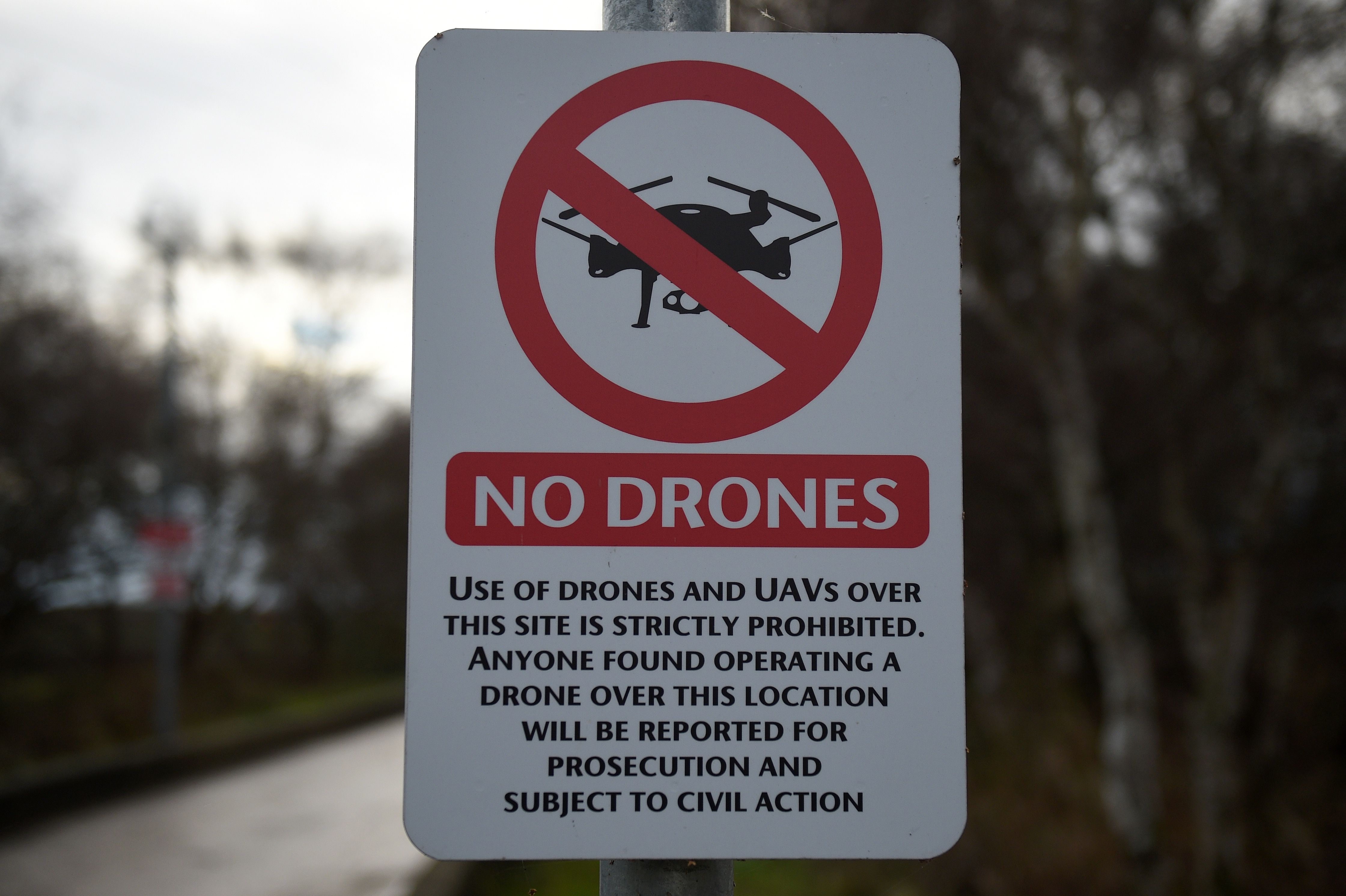 "A ""No Drones"" sign alerting members of the public that the use of drones or unmanned aerial vehicles (UAV) is prohibited, is pictured outside Manchester United's Carrington Training complex in Manchester, north west England on December 20, 2018.(OLI SCARFF/AFP/Getty Images)"
