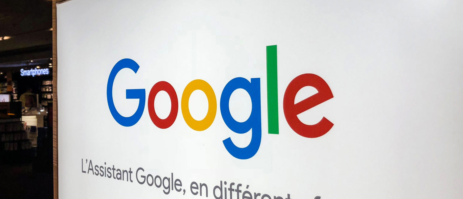 The logo of US multinational technology company Google with the subtitle in French 'Google Assistant in different formats' is seen at a store in Lille, northern France, on August 3, 2018. (Photo: DENIS CHARLET/AFP/Getty Images)