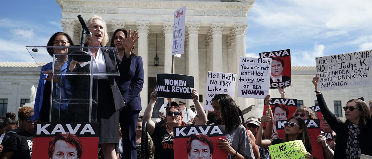 WASHINGTON, DC - SEPTEMBER 28: U.S. Sen. Kirsten Gillibrand (D-NY) (2nd L) speaks as Sen. Mazie Hirono (D-HI) (L) and Sen. Kamala Harris (D-CA) (R) listen during a rally in front of the U.S. Supreme Court September 28, 2018 in Washington, DC. Activists staged a rally to call to drop the nomination of Judge Brett Kavanaugh to the U.S. Supreme Court. (Alex Wong/Getty Images)