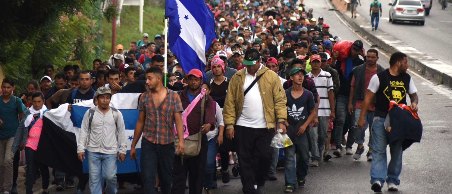 TOPSHOT - Honduran migrants take part in a caravan towards the United States in Chiquimula, Guatemala on October 17, 2018. - A migrant caravan set out on October 13 from the impoverished, violence-plagued country and was headed north on the long journey through Guatemala and Mexico to the US border. President Donald Trump warned Honduras he will cut millions of dollars in aid if the group of about 2,000 migrants is allowed to reach the United States. (Photo by ORLANDO ESTRADA / AFP) (Photo credit should read ORLANDO ESTRADA/AFP/Getty Images)