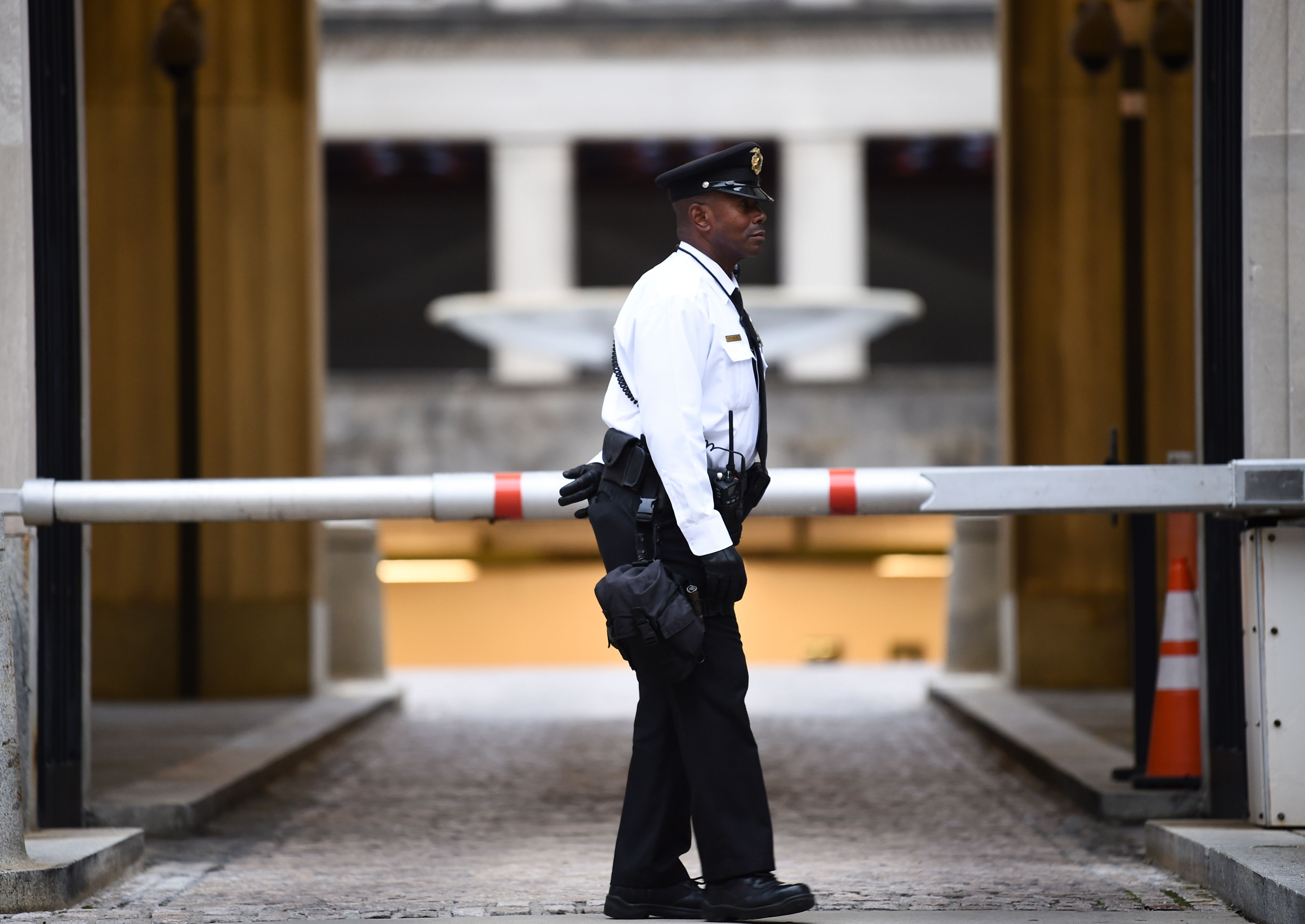 A police officer mans a gate outside the Department of Justice building in Washington, DC on November 7, 2018. (BRENDAN SMIALOWSKI/AFP/Getty Images)