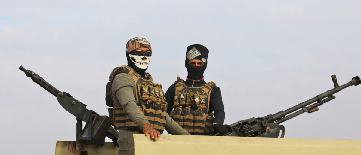 An Iraqi paramilitary unit from the Hashed al-Shaabi stands guard near the Iraqi city of Qaim at the Iraqi-Syrian border on November 11, 2018. - Iraqi troops reinforced their positions along the porous frontier with neighbouring war-torn Syria, fearing a spillover from clashes there between Islamic State group and US-backed forces. (Photo by AHMAD AL-RUBAYE / AFP) (Photo credit should read AHMAD AL-RUBAYE/AFP/Getty Images)