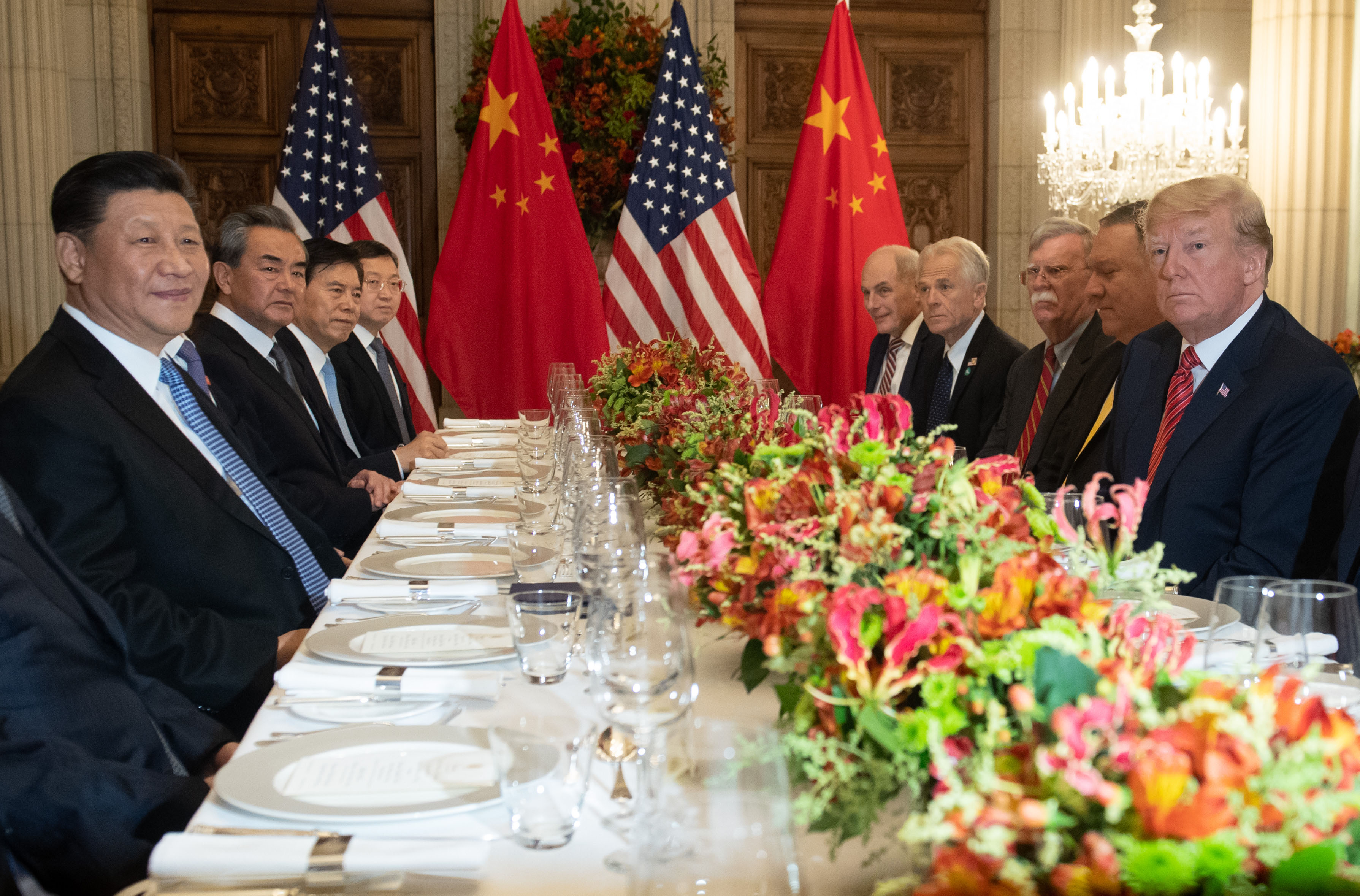US President Donald Trump (R) US Secretary of State Mike Pompeo (2-R) and members of their delegation hold a dinner meeting with China's President Xi Jinping (L) Chinas Foreign Affairs Minister Wang Yi (2-L) and Chinese government representatives, at the end of the G20 Leaders' Summit in Buenos Aires, on December 01, 2018. (SAUL LOEB/AFP/Getty Images)