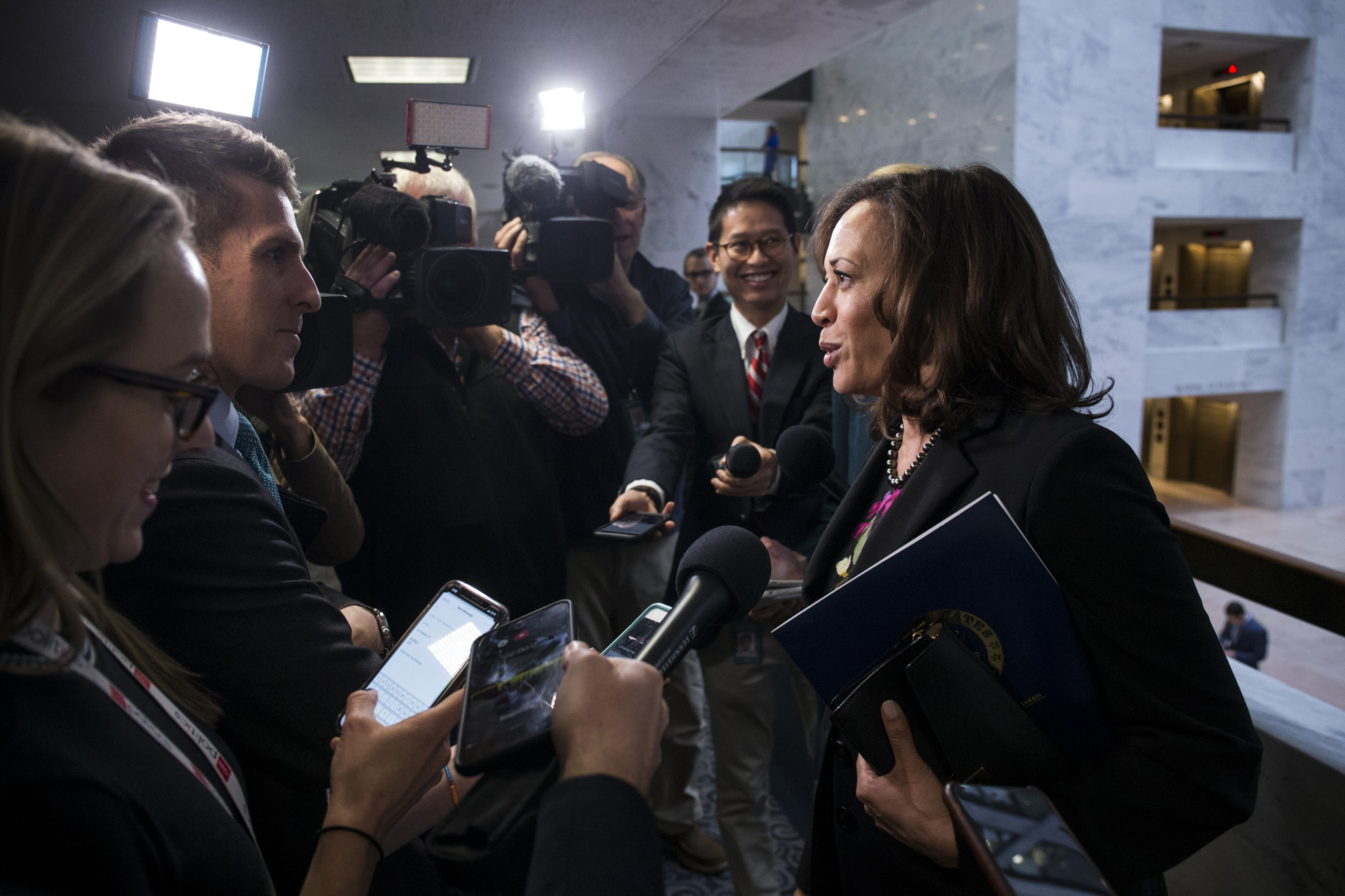 Sen. Kamala Harris speaks to reporters following a closed briefing on intelligence matters on Capitol Hill on December 4, 2018 in Washington, DC. (Photo by Zach Gibson/Getty Images)